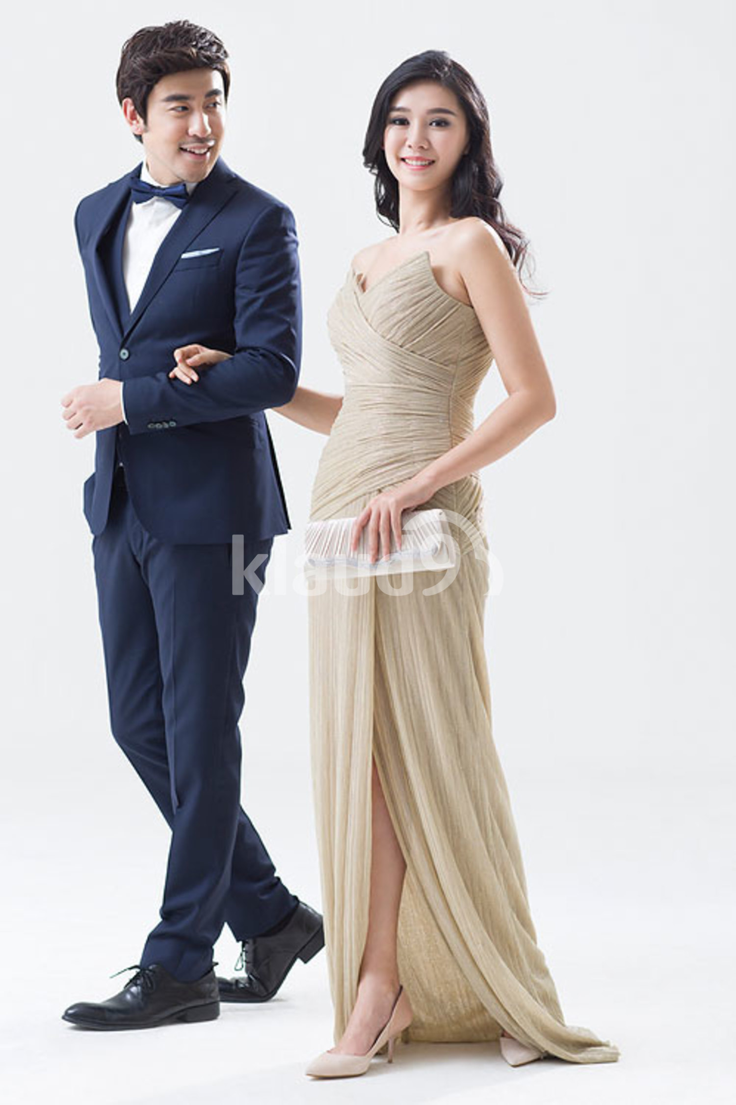 Elegant young Chinese couple walking