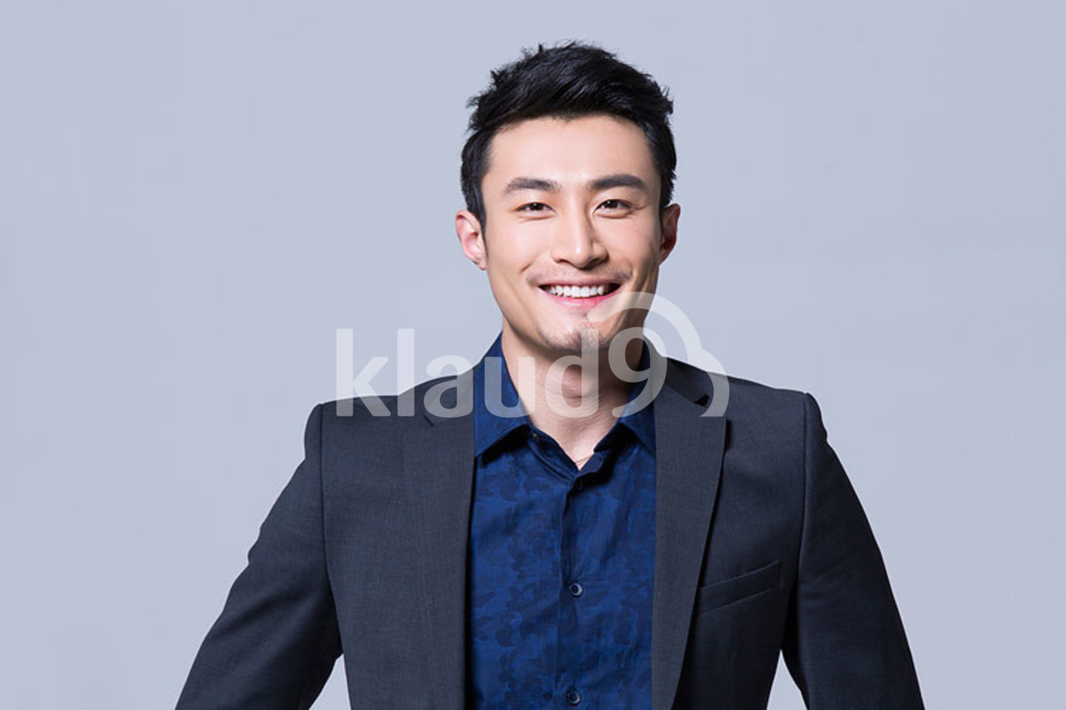 Smiling young Chinese businessman
