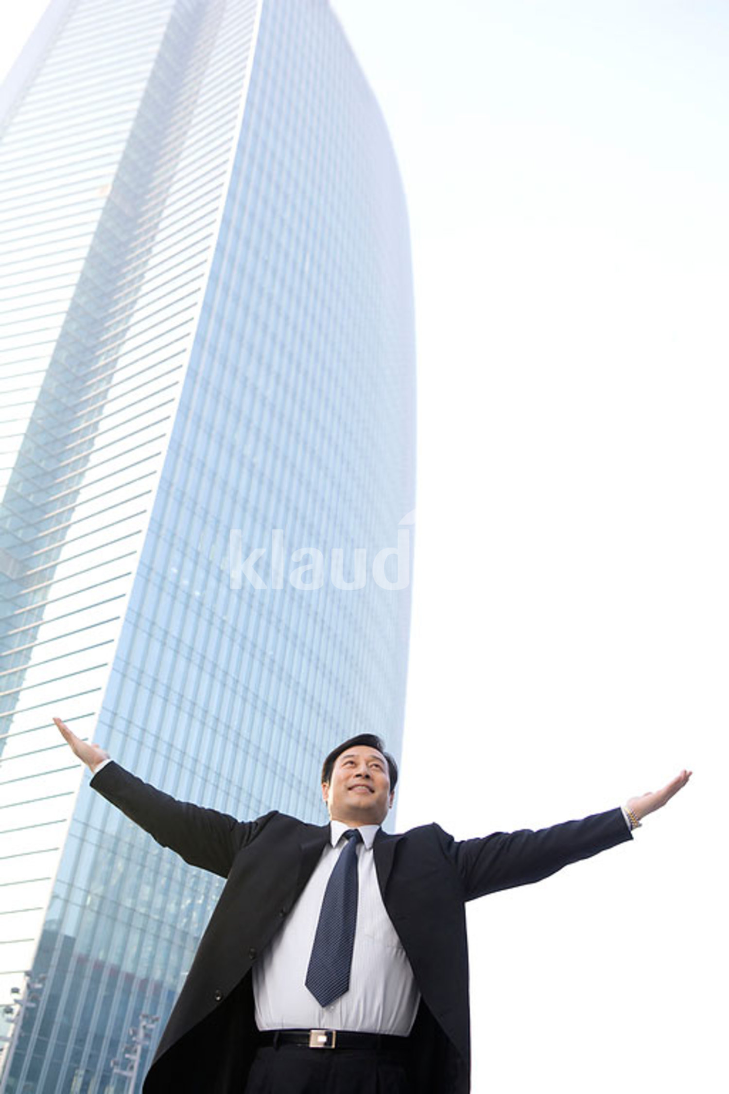 Chinese business Leader With Arms Outstretched