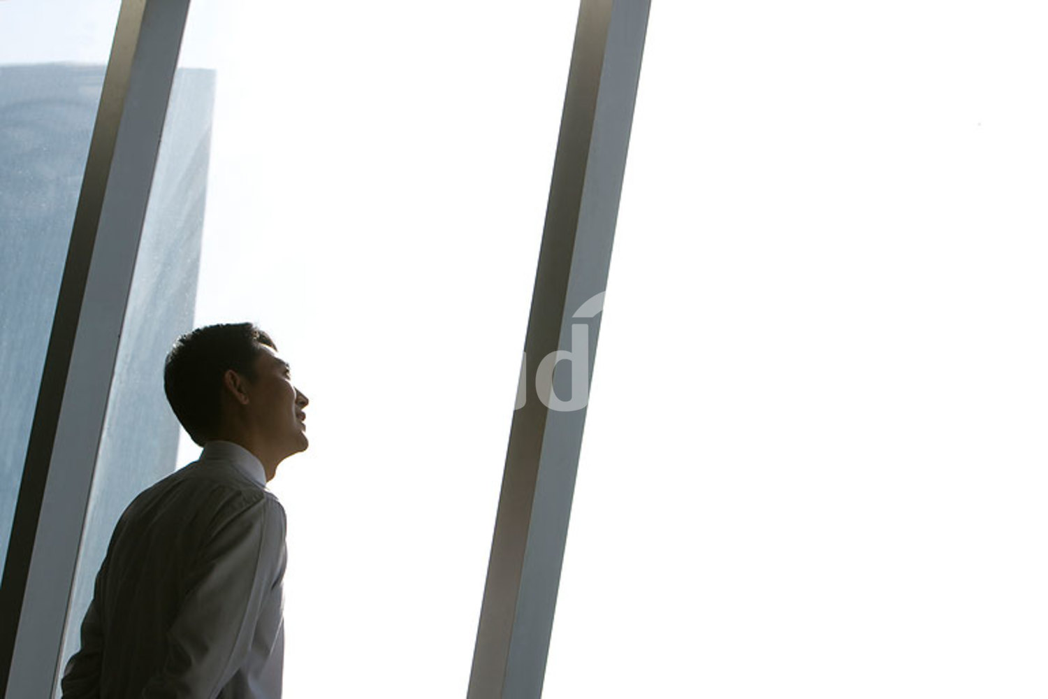 Chinese businessman looking at window