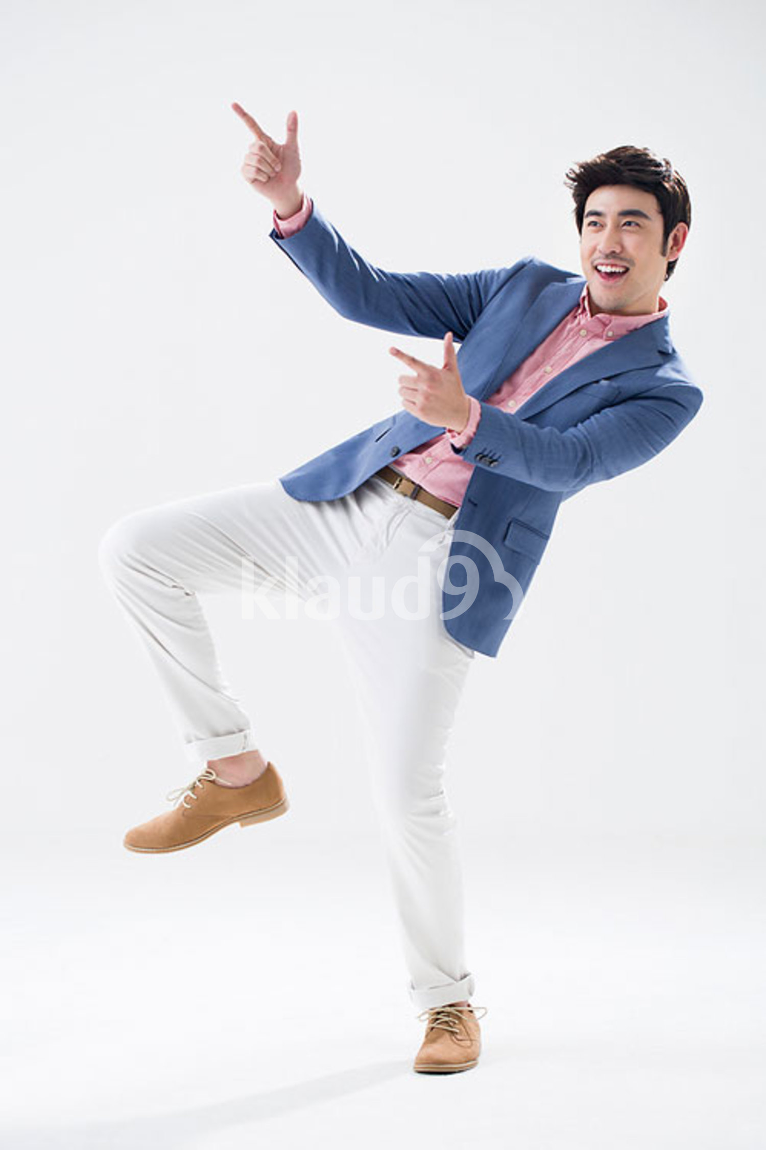 Fashionable young Chinese man pointing