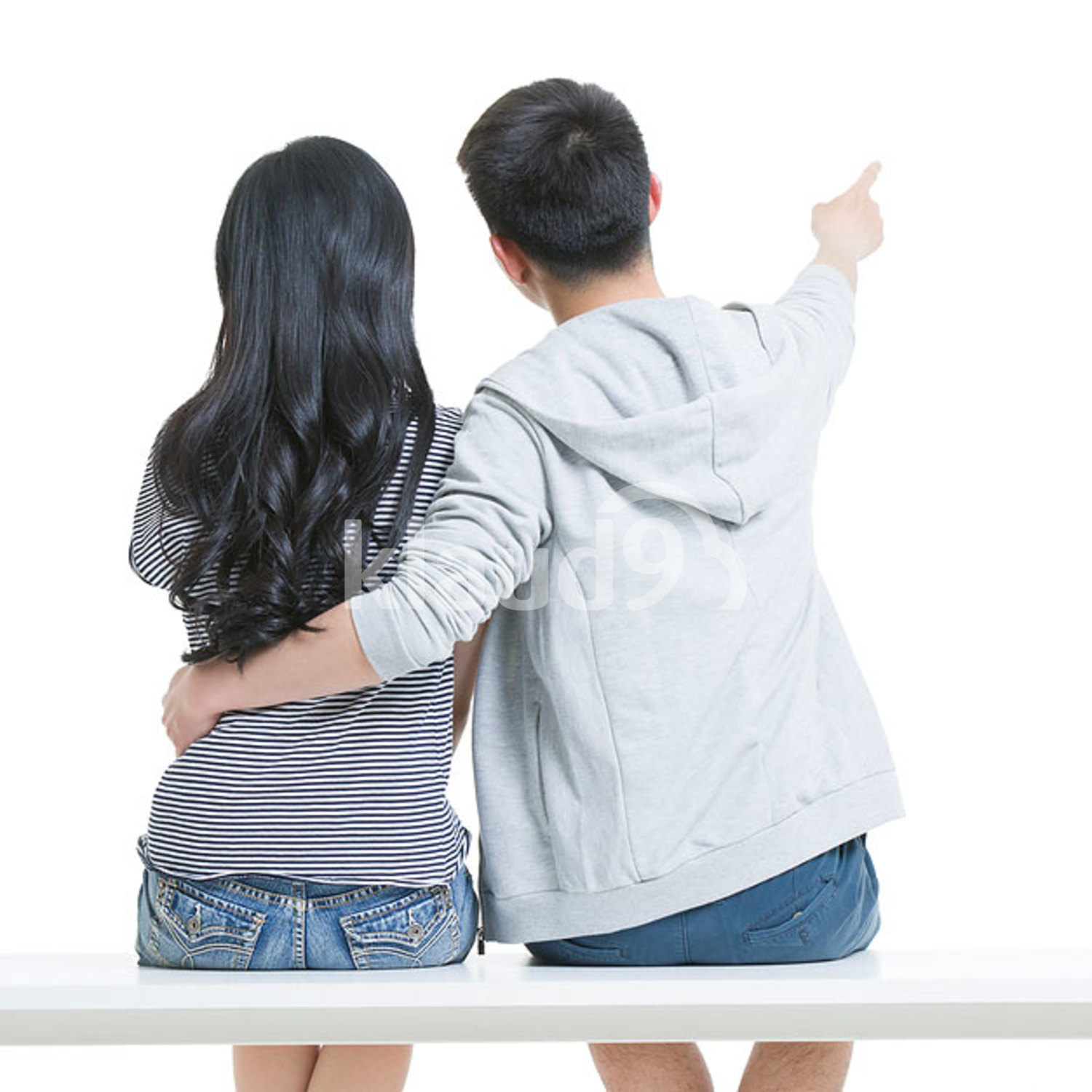 Happy young Chinese couple pointing