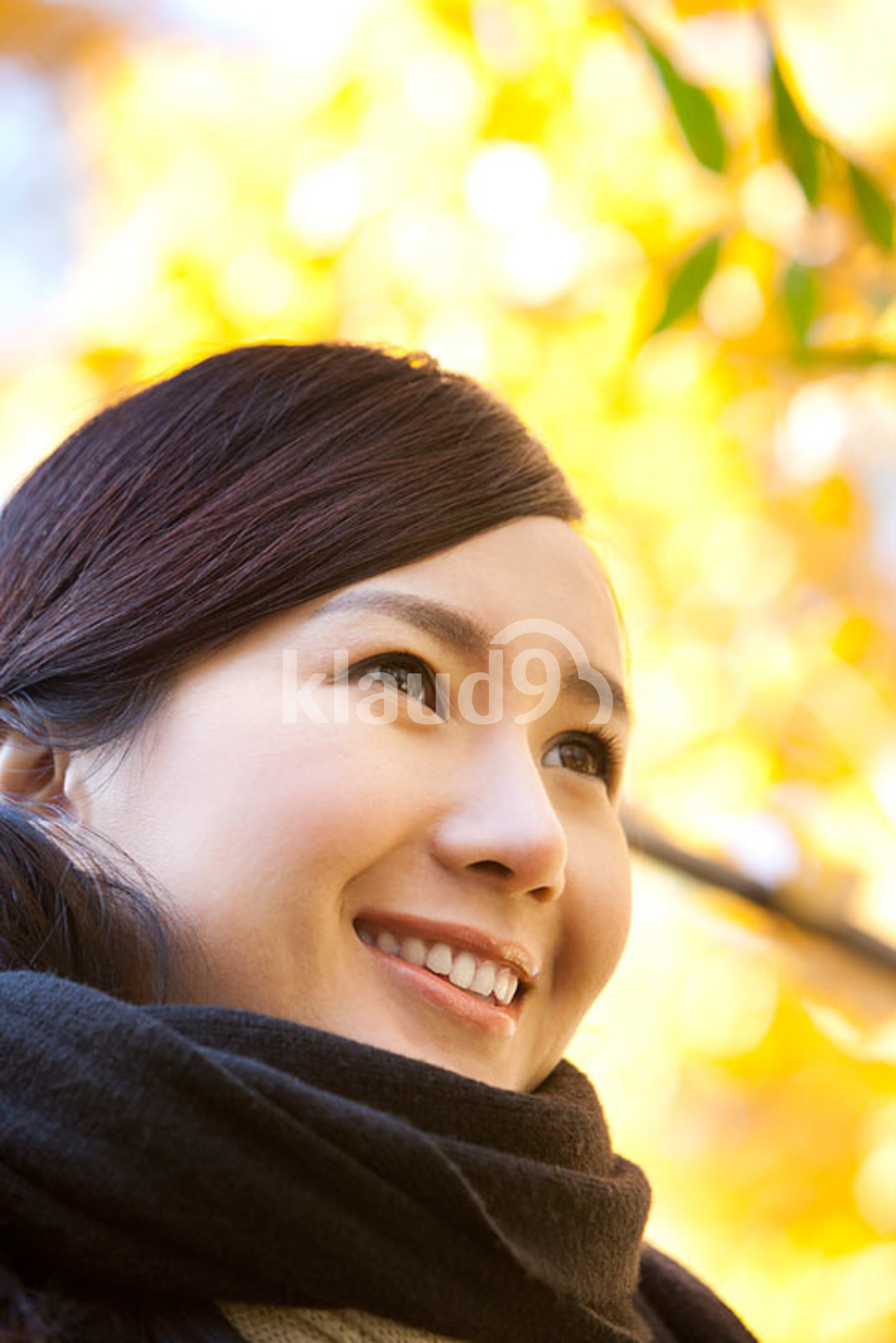 Young Chinese woman with a scarf in autumn
