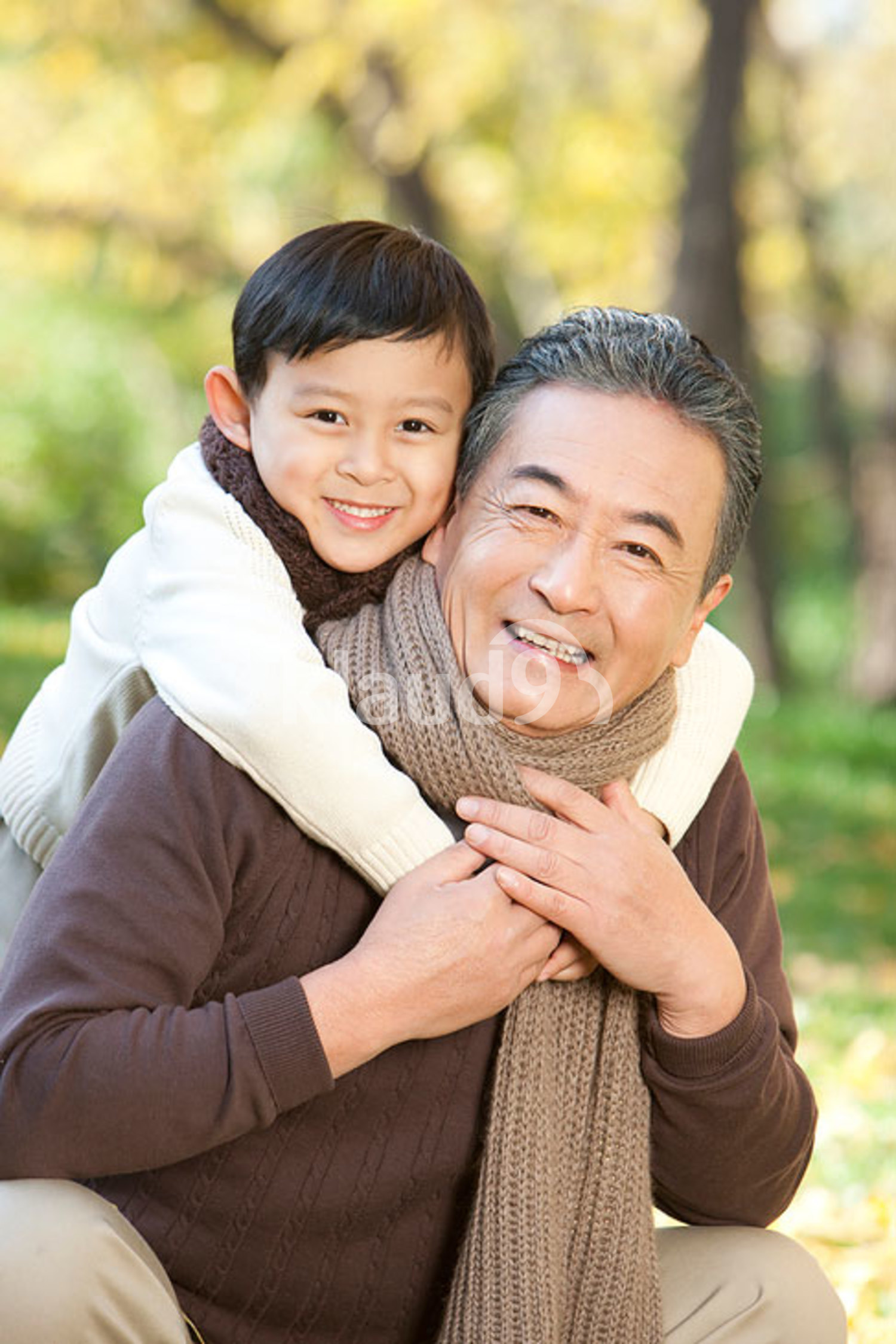 Chinese boy embracing his grandfather