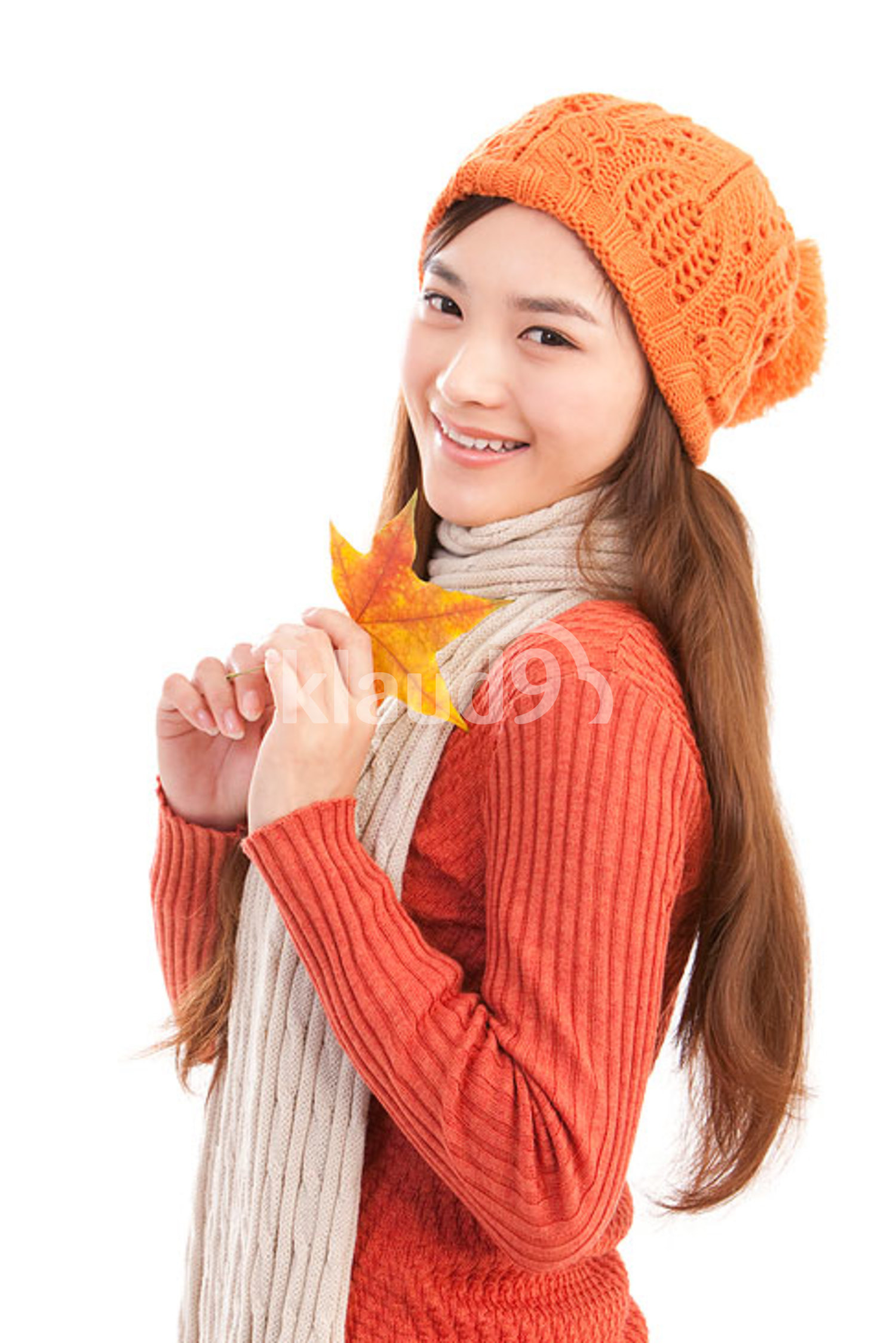 Portrait of young Chinese woman,maple leaf in hand