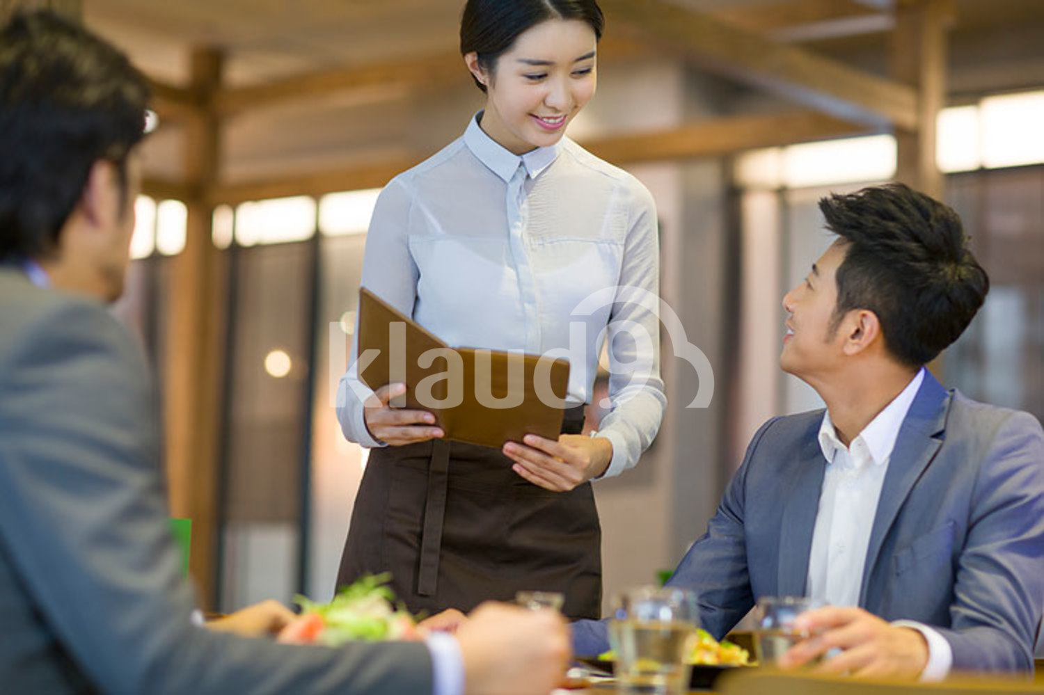 Chinese businessman talking with waitress