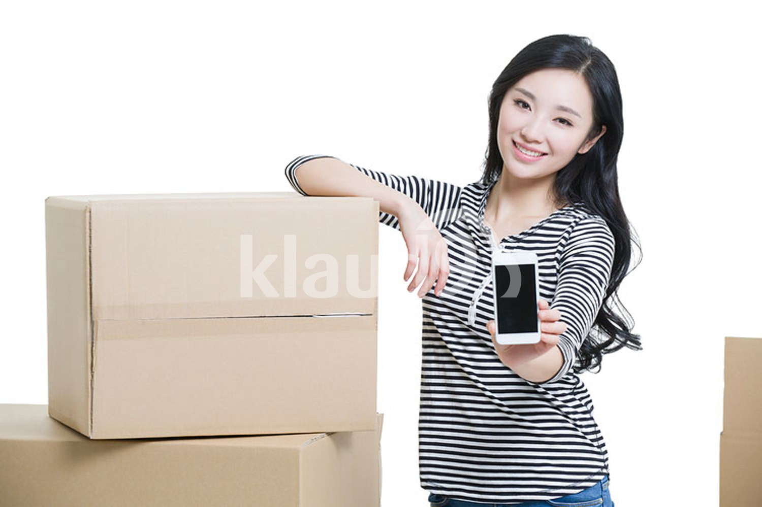 Young Chinese woman moving house and showing a smart phone
