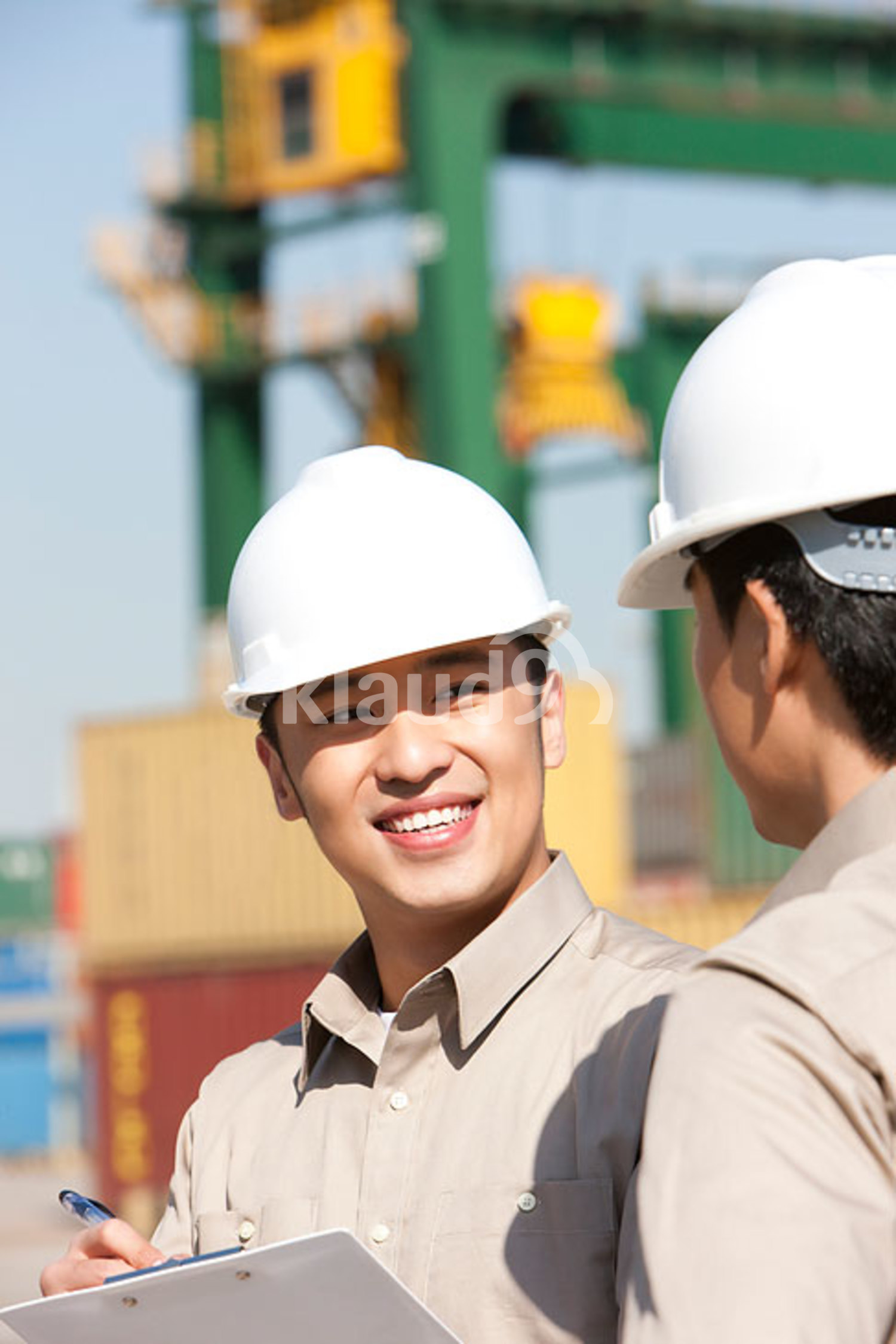 Male Chinese shipping industry workers working together