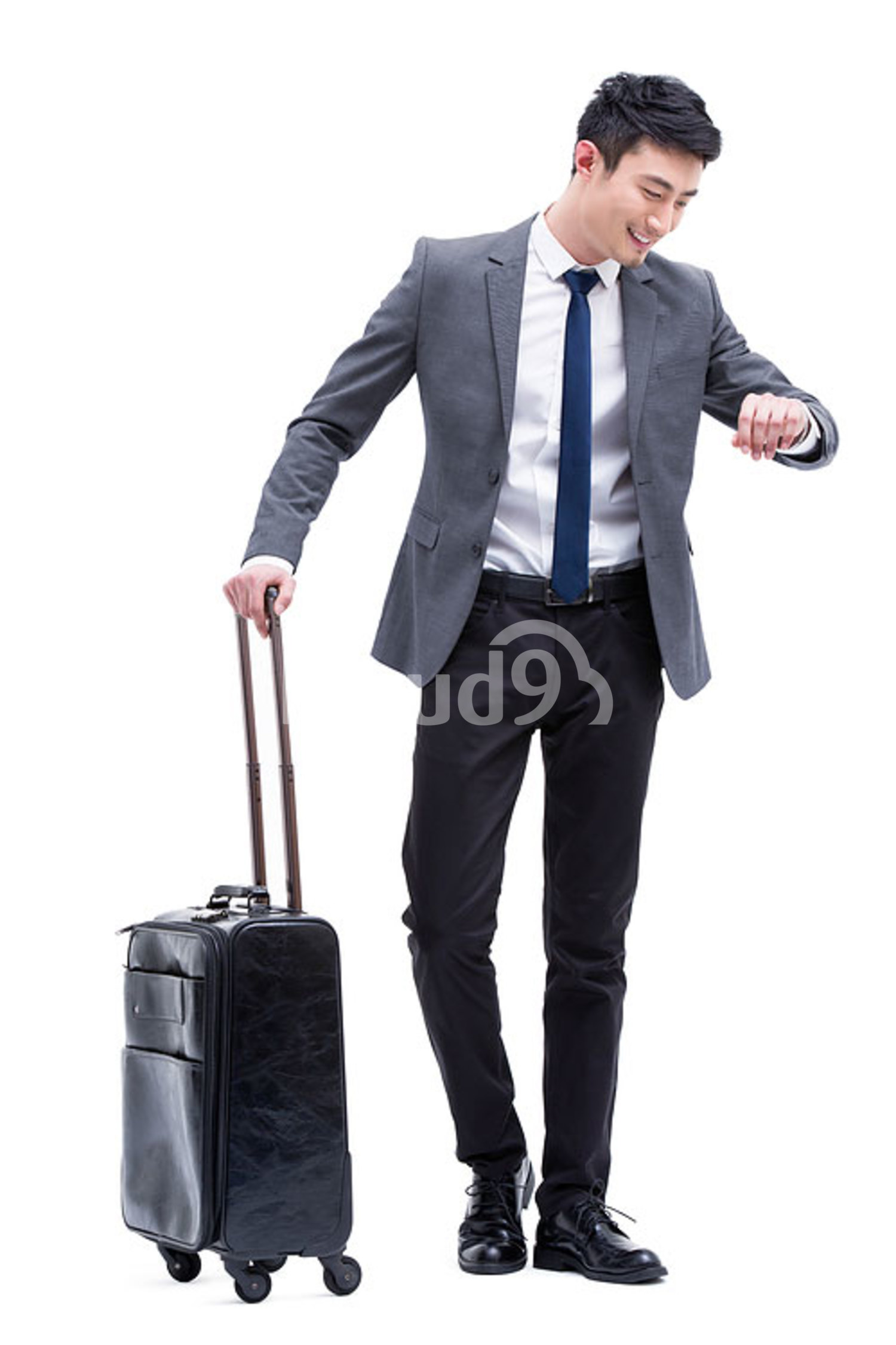 Fashionable Chinese businessman in travel checking the time