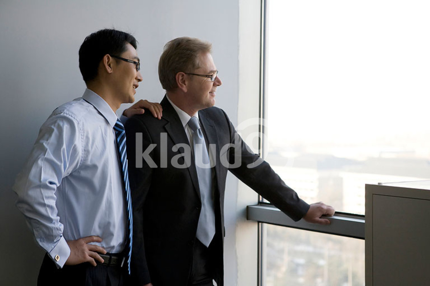 Businessmen looking out the window