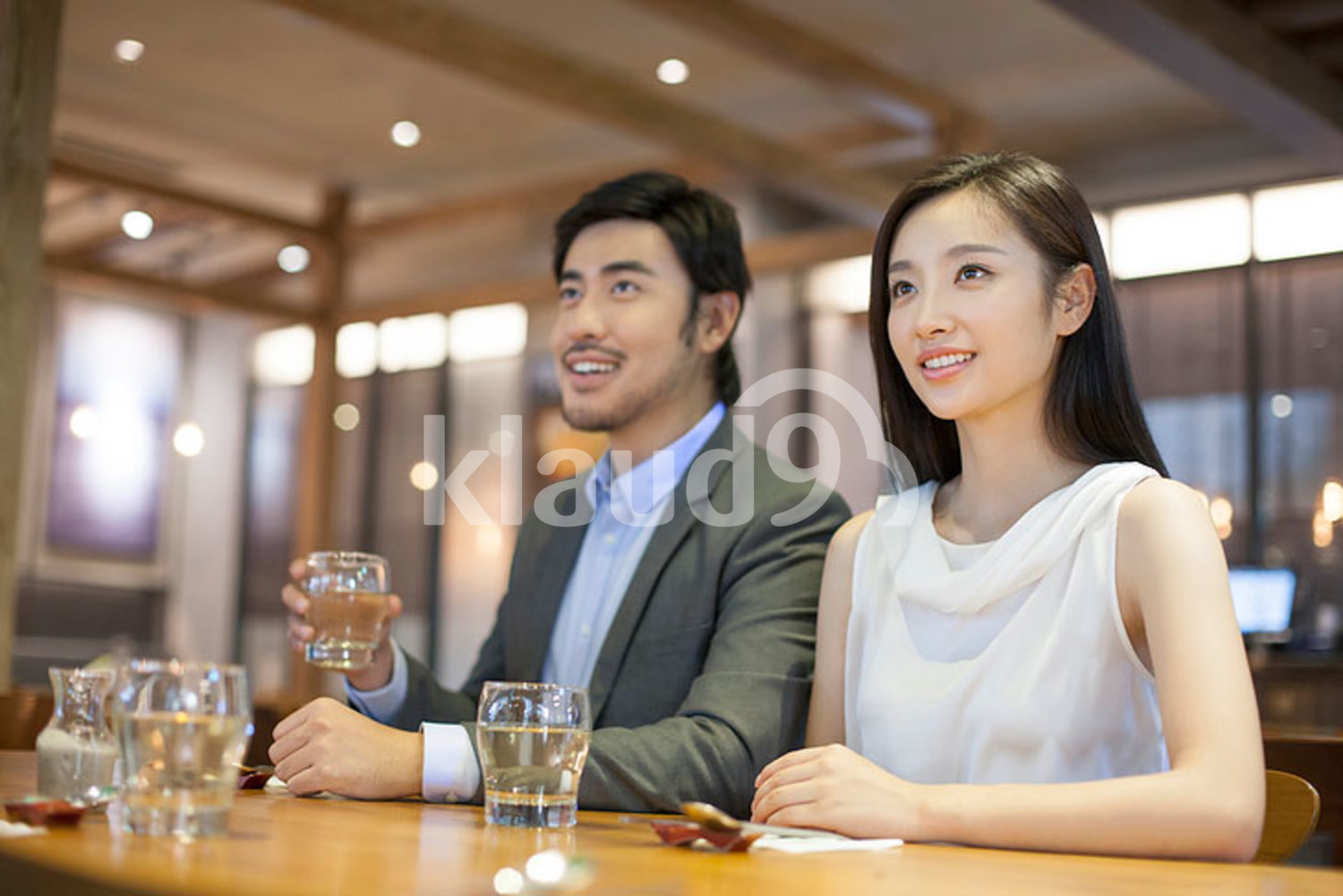 Young Chinese couple having dinner together