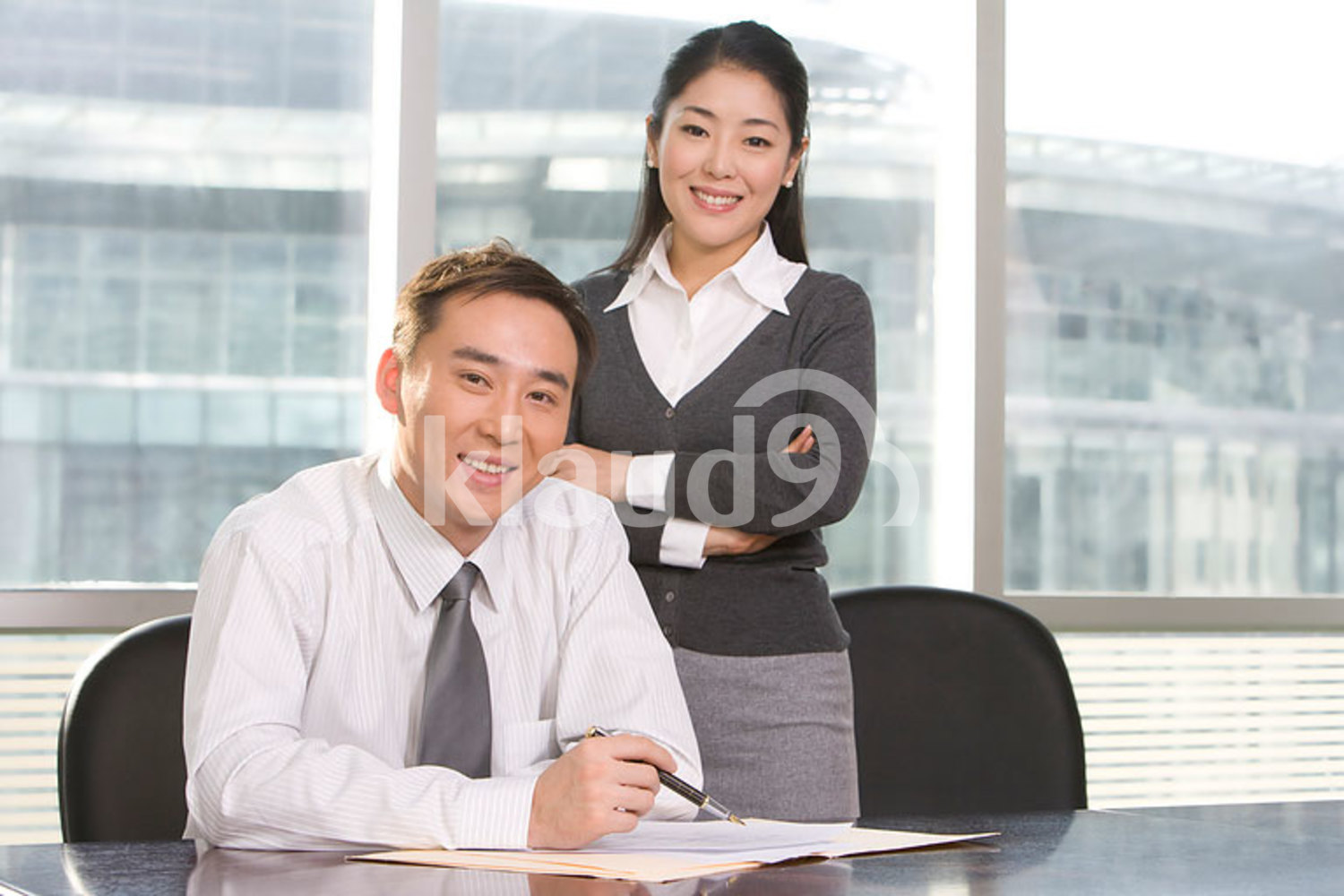 Chinese businesspeople in a meeting