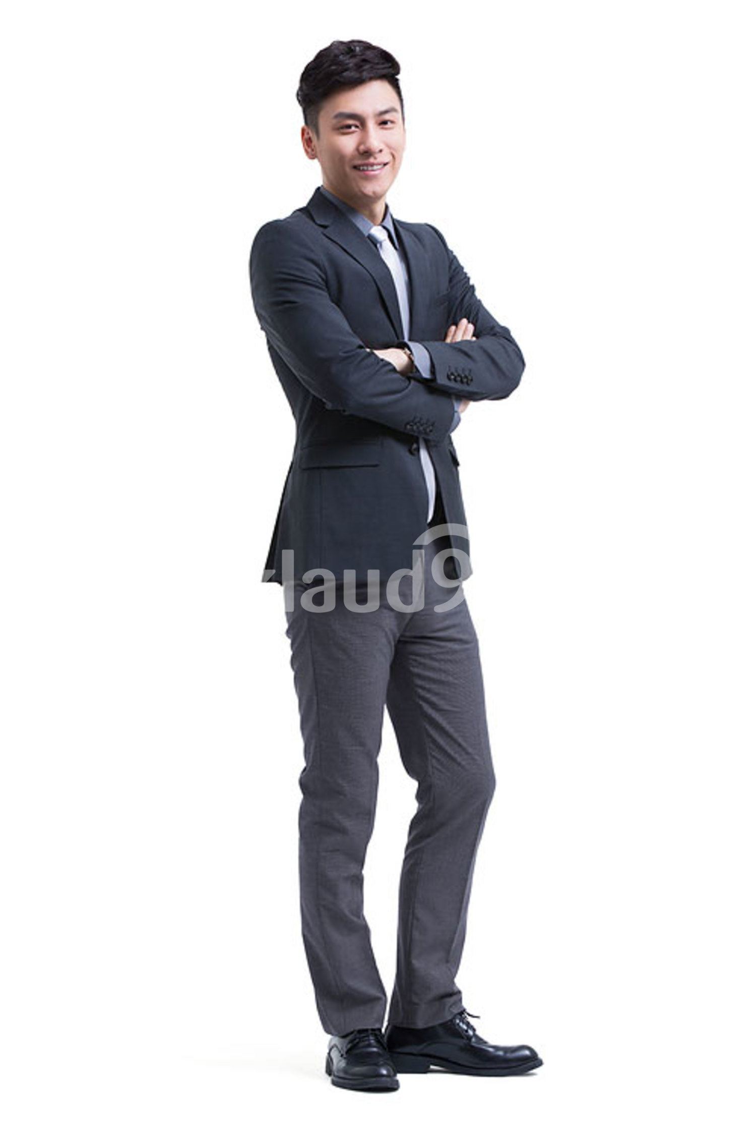Confident Chinese businessman arms crossed