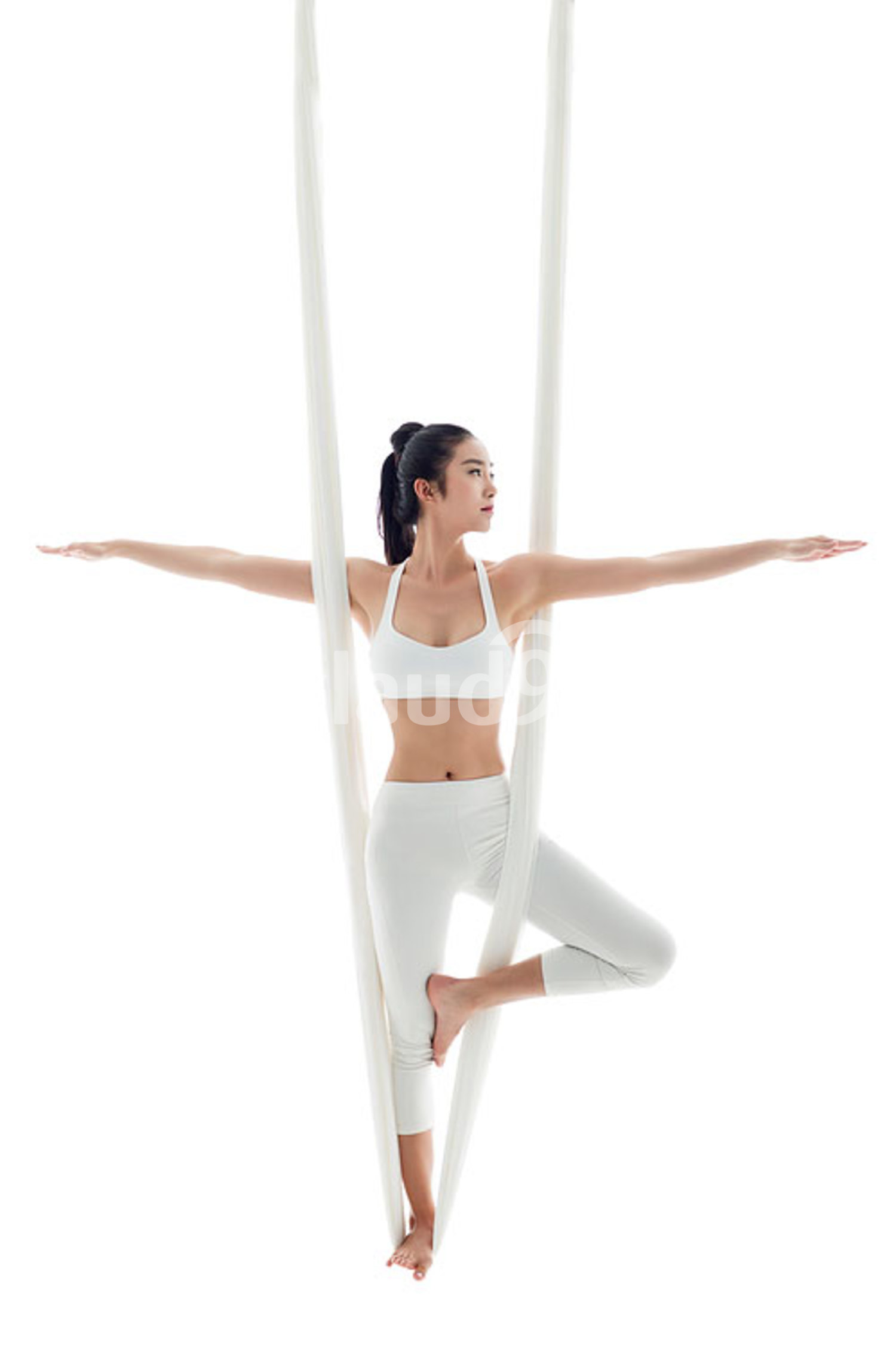 Young Chinese woman practicing aerial yoga