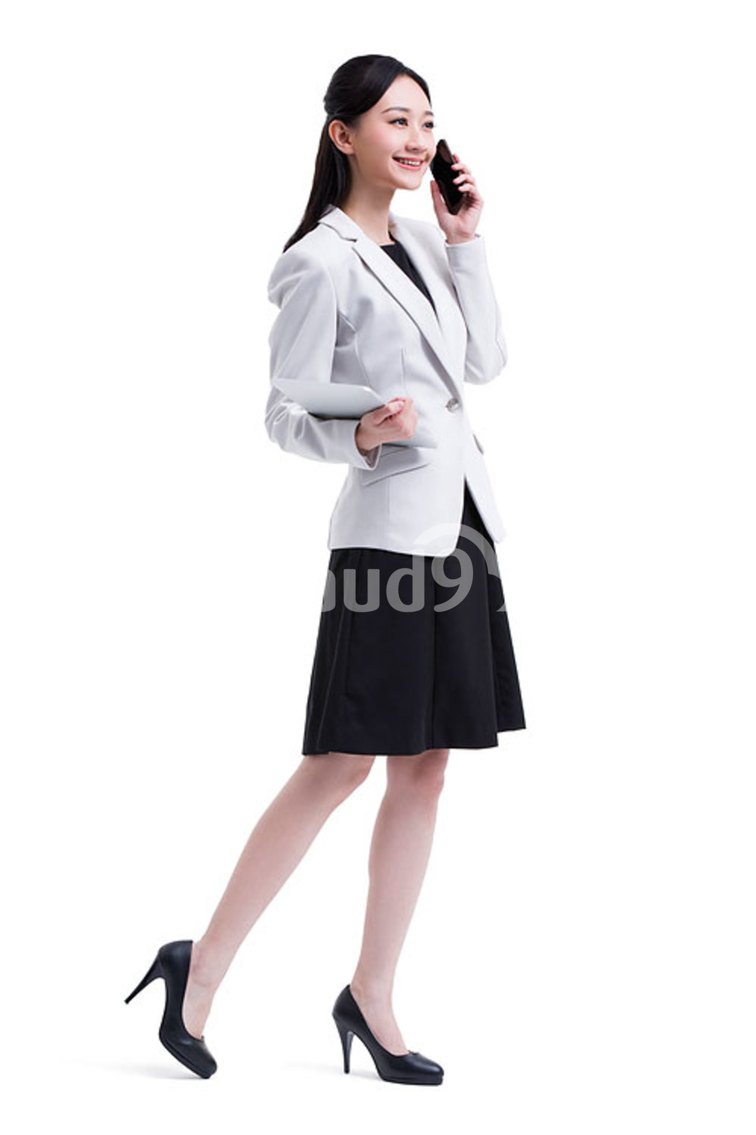 Young Chinese businesswoman talking on the phone