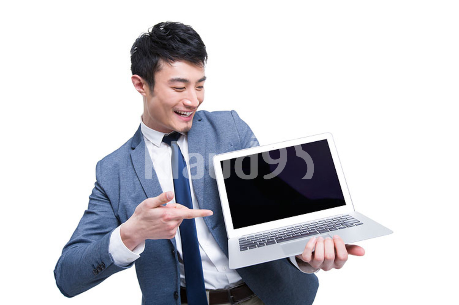 Young Chinese businessman with laptop