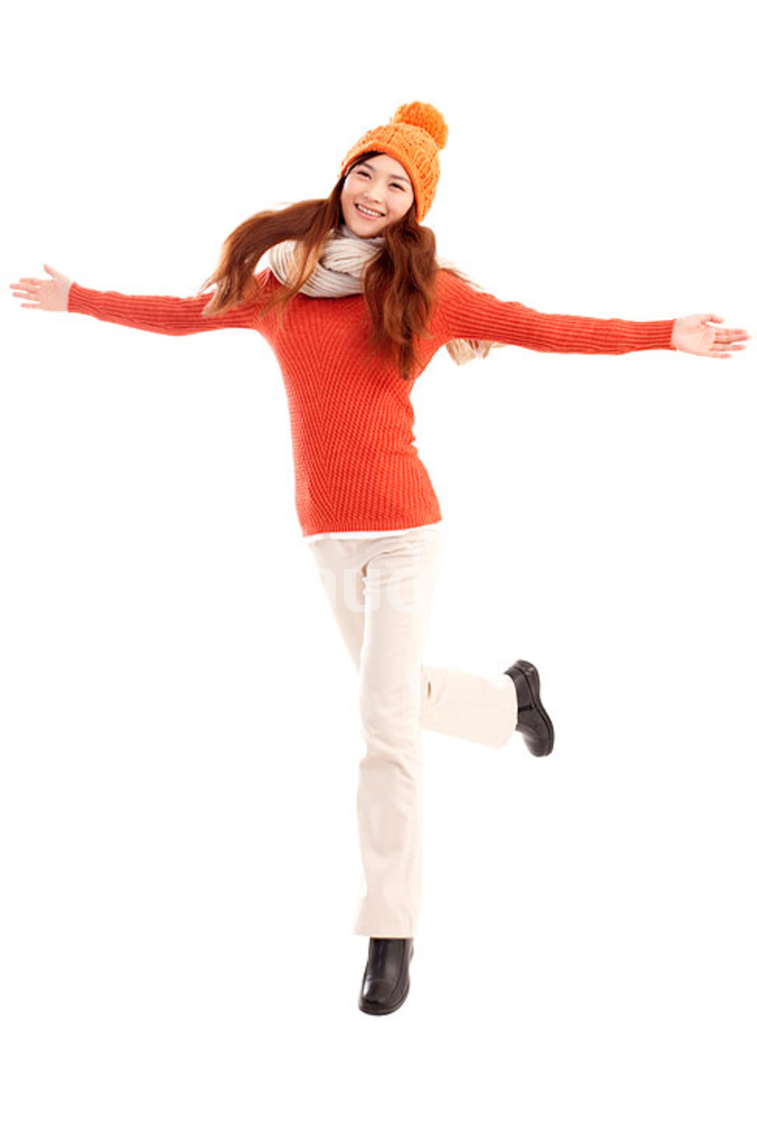Happy young Chinese woman arms outstretched