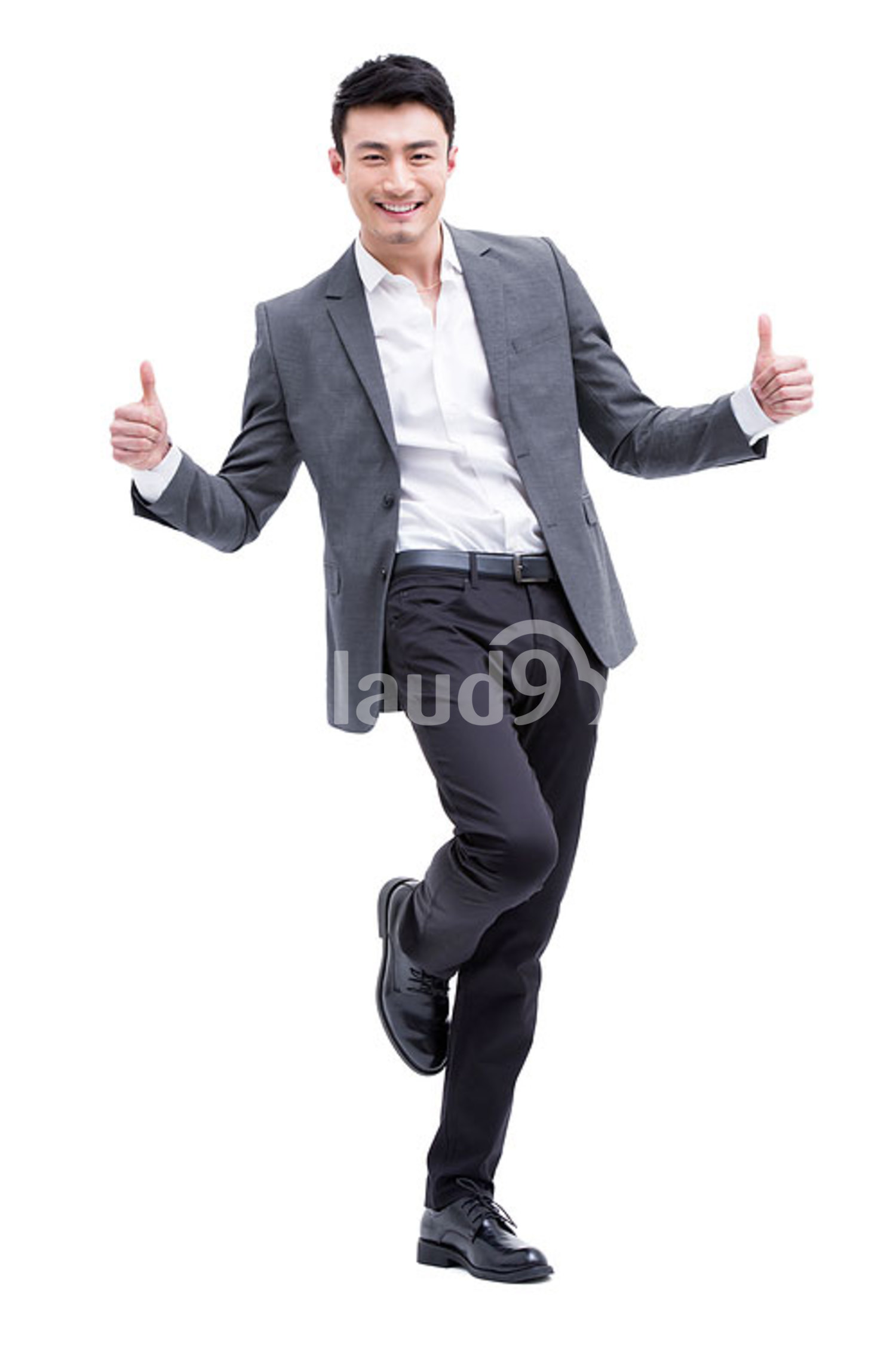 Fashionable Chinese businessman doing thumbs up