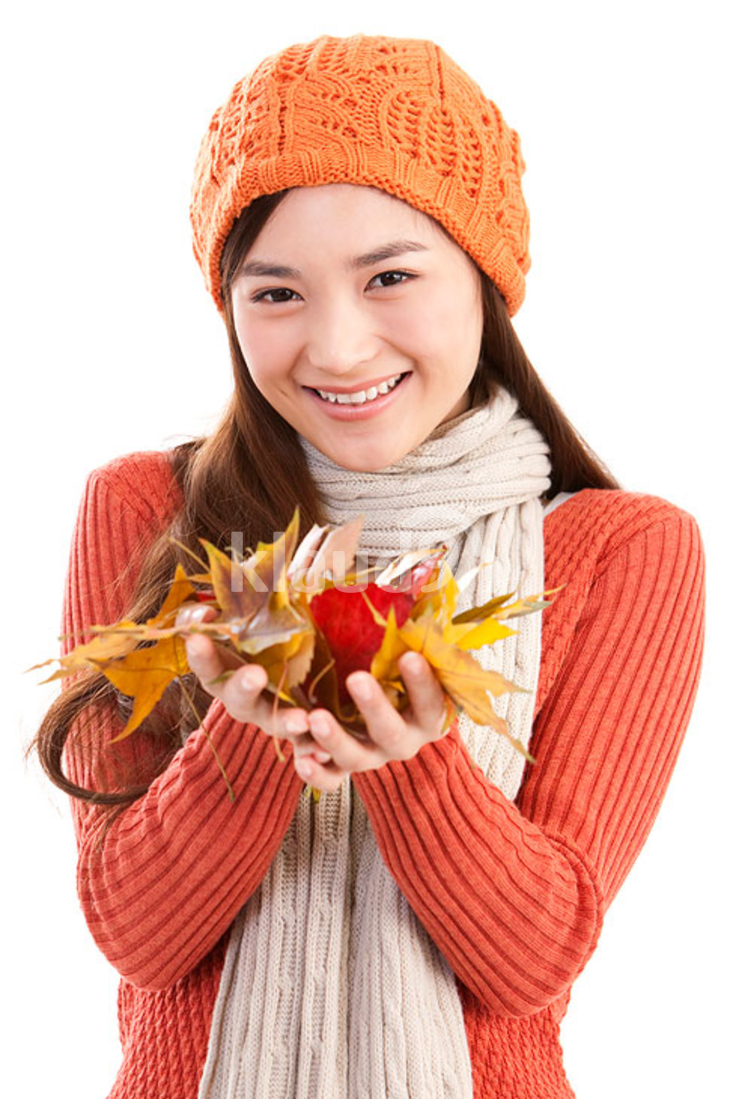 Young Chinese woman holding maple leaves