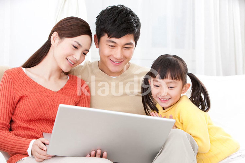 Chinese family using laptop