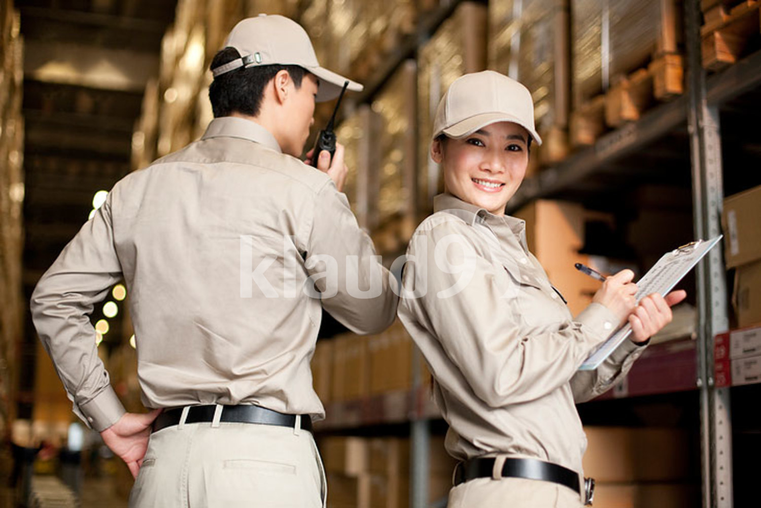 Male and female Chinese warehouse workers