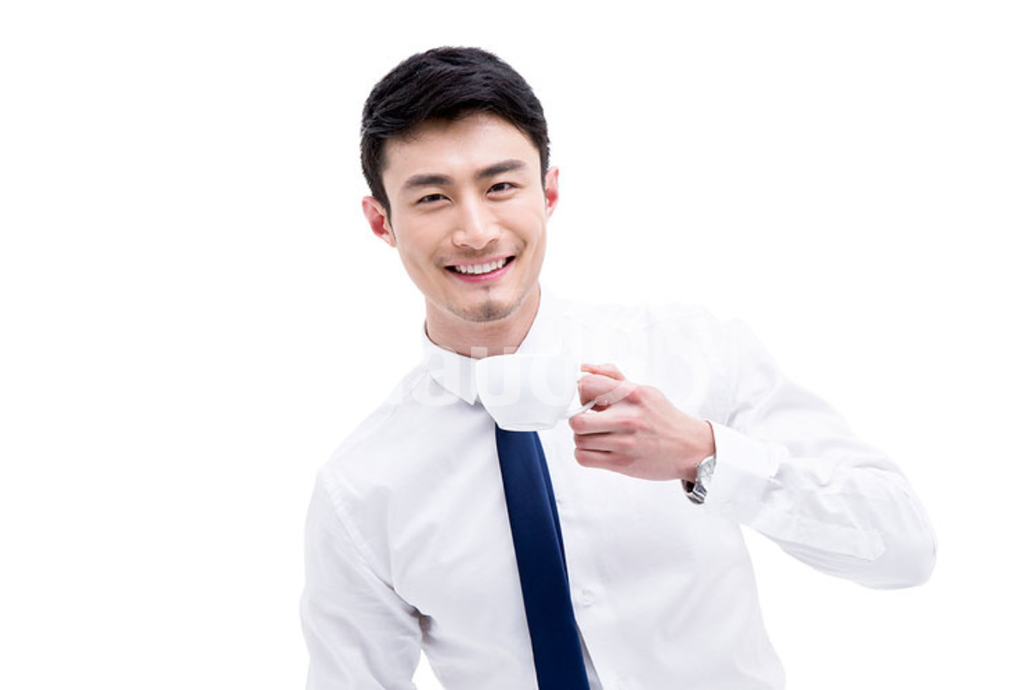Young Chinese businessman drinking tea