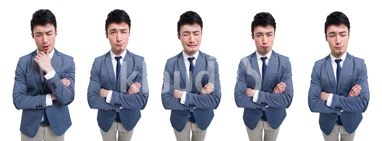 Funny Chinese businessman with hand on chin