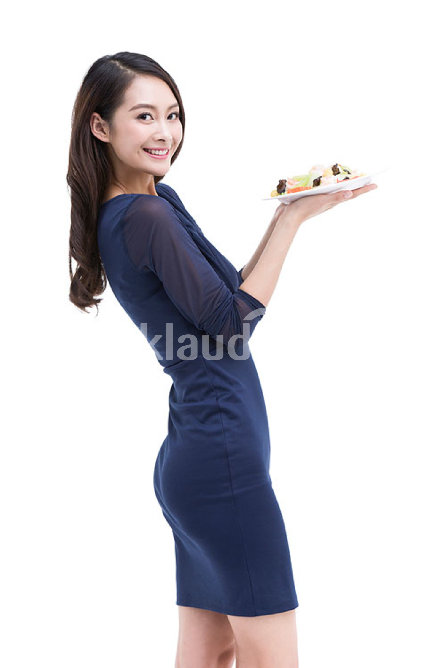 Happy young Chinese woman serving food
