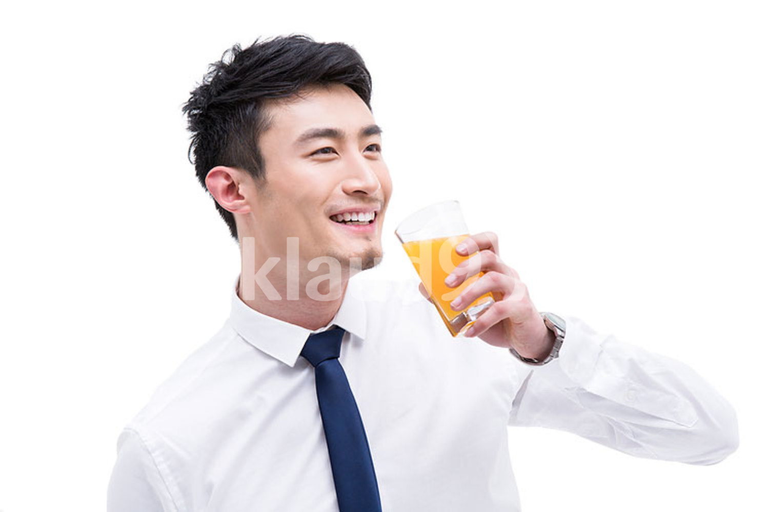 Young Chinese businessman drinking orange juice