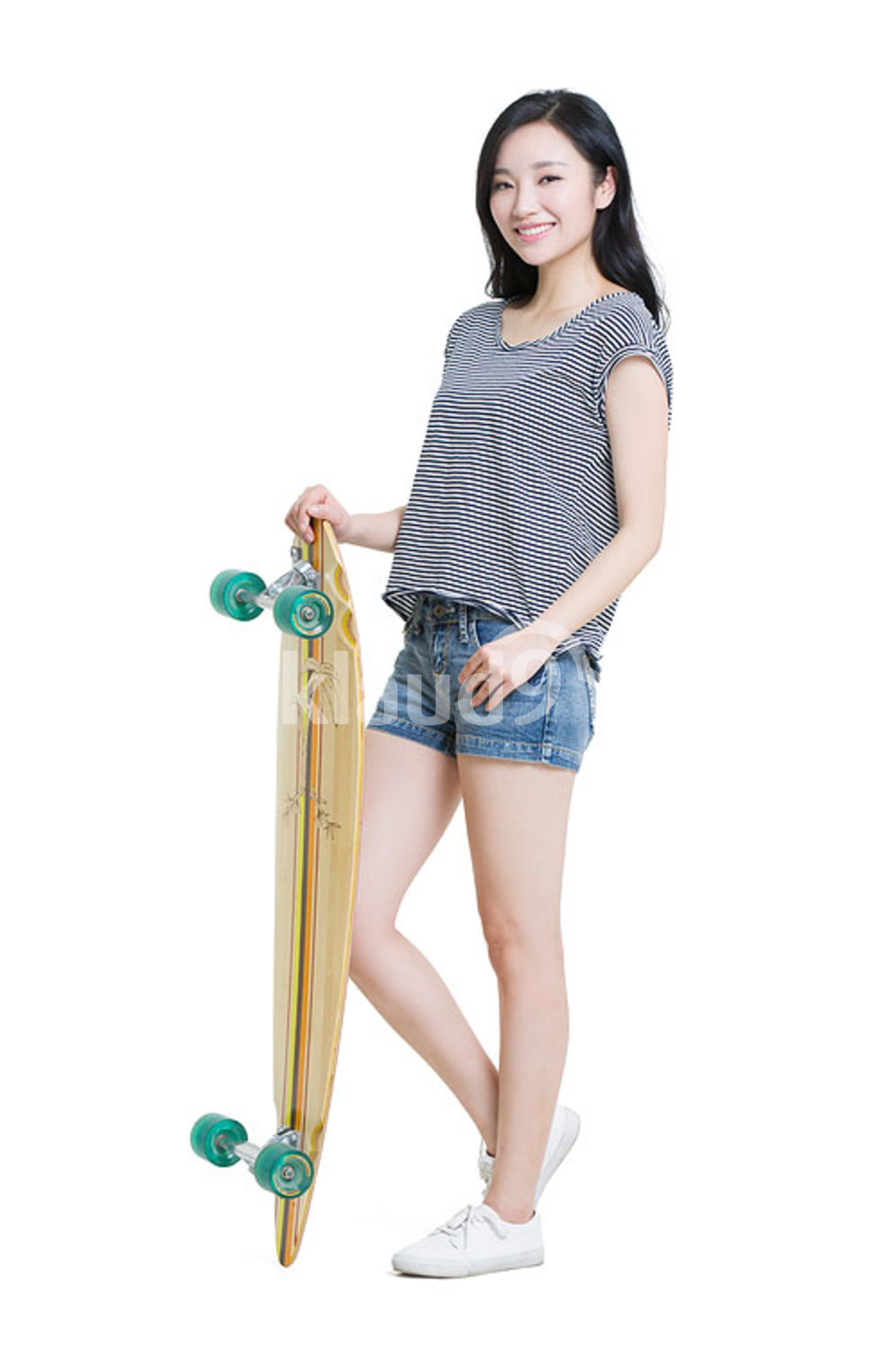 Happy young Chinese woman holding a skateboard