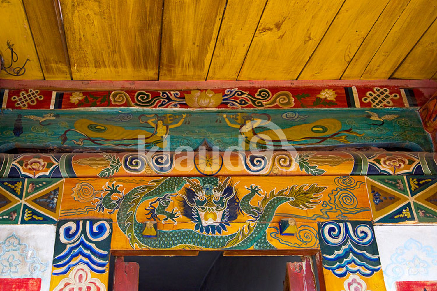 Ancient Chinese doorframe with dragon pattern