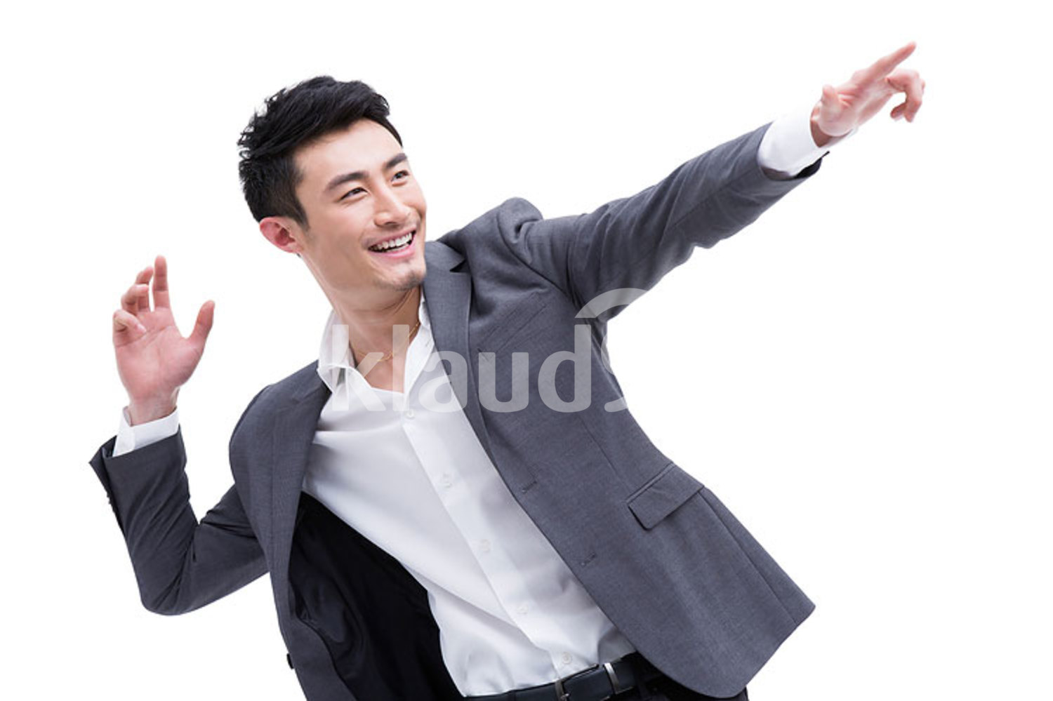 Fashionable Chinese businessman pointing away