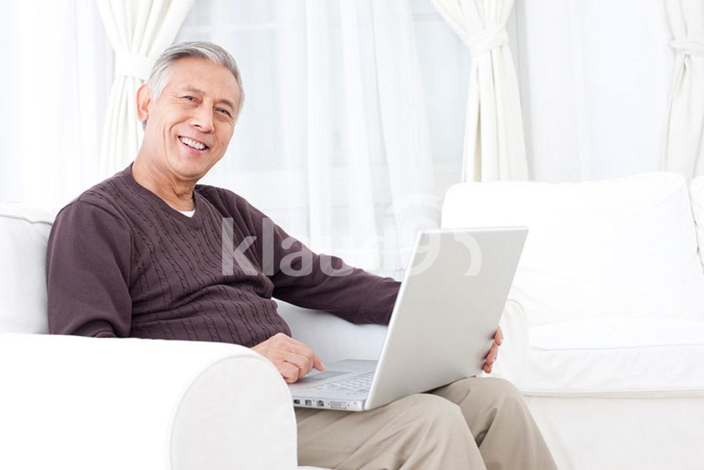 Senior Chinese man using laptop