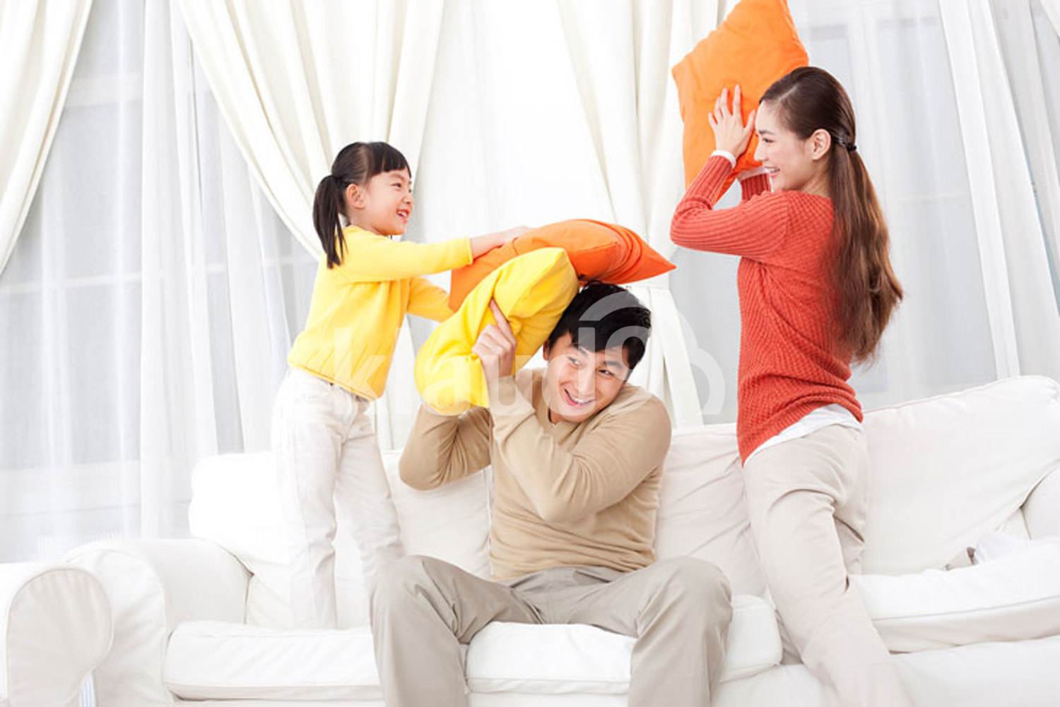 Chinese family doing pillow fighting