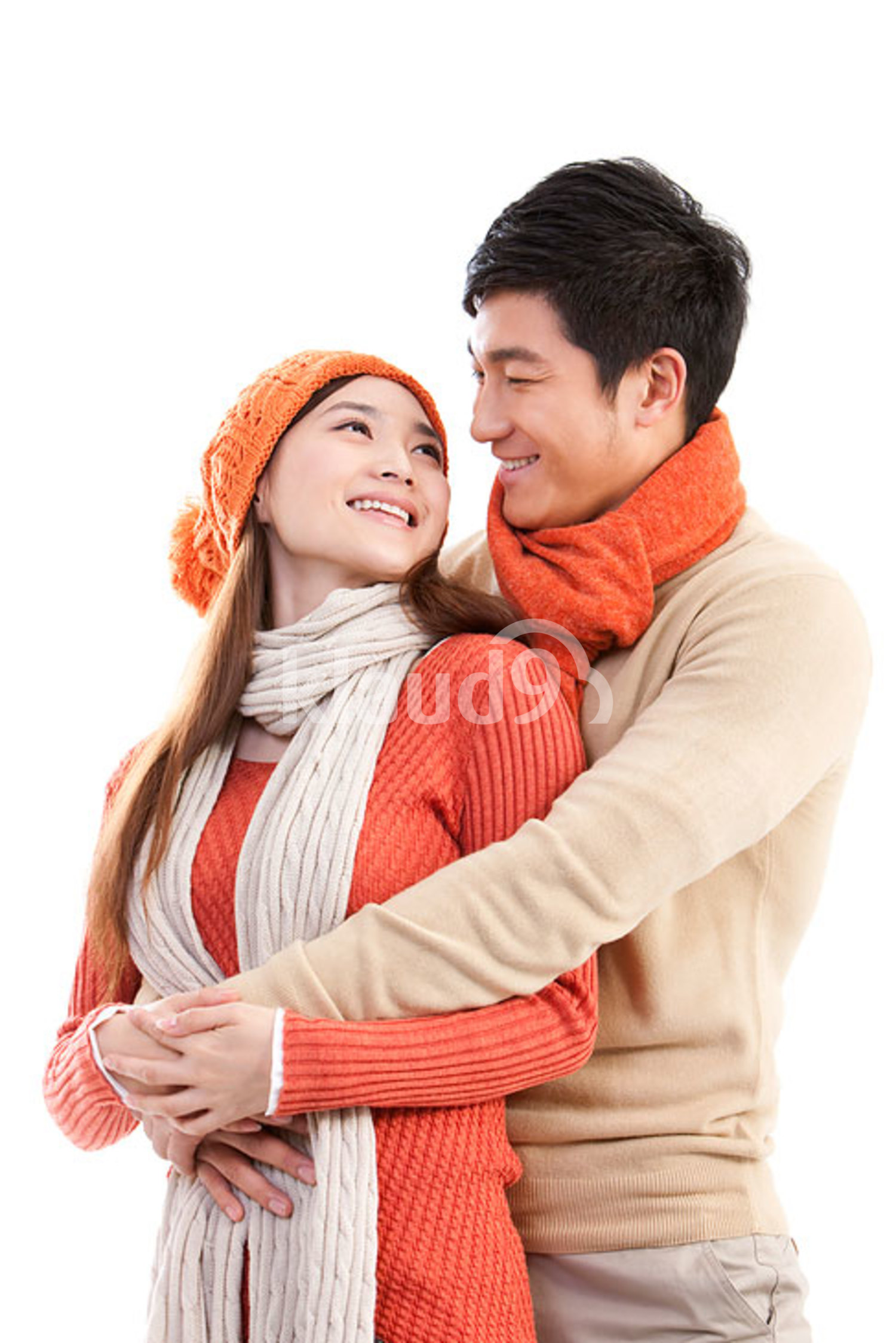 Young affectionate Chinese couple embracing