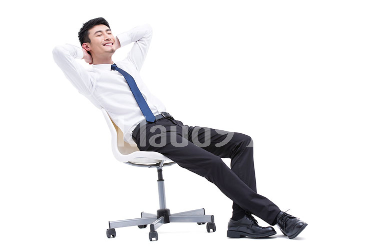 Young Chinese businessman resting in chair