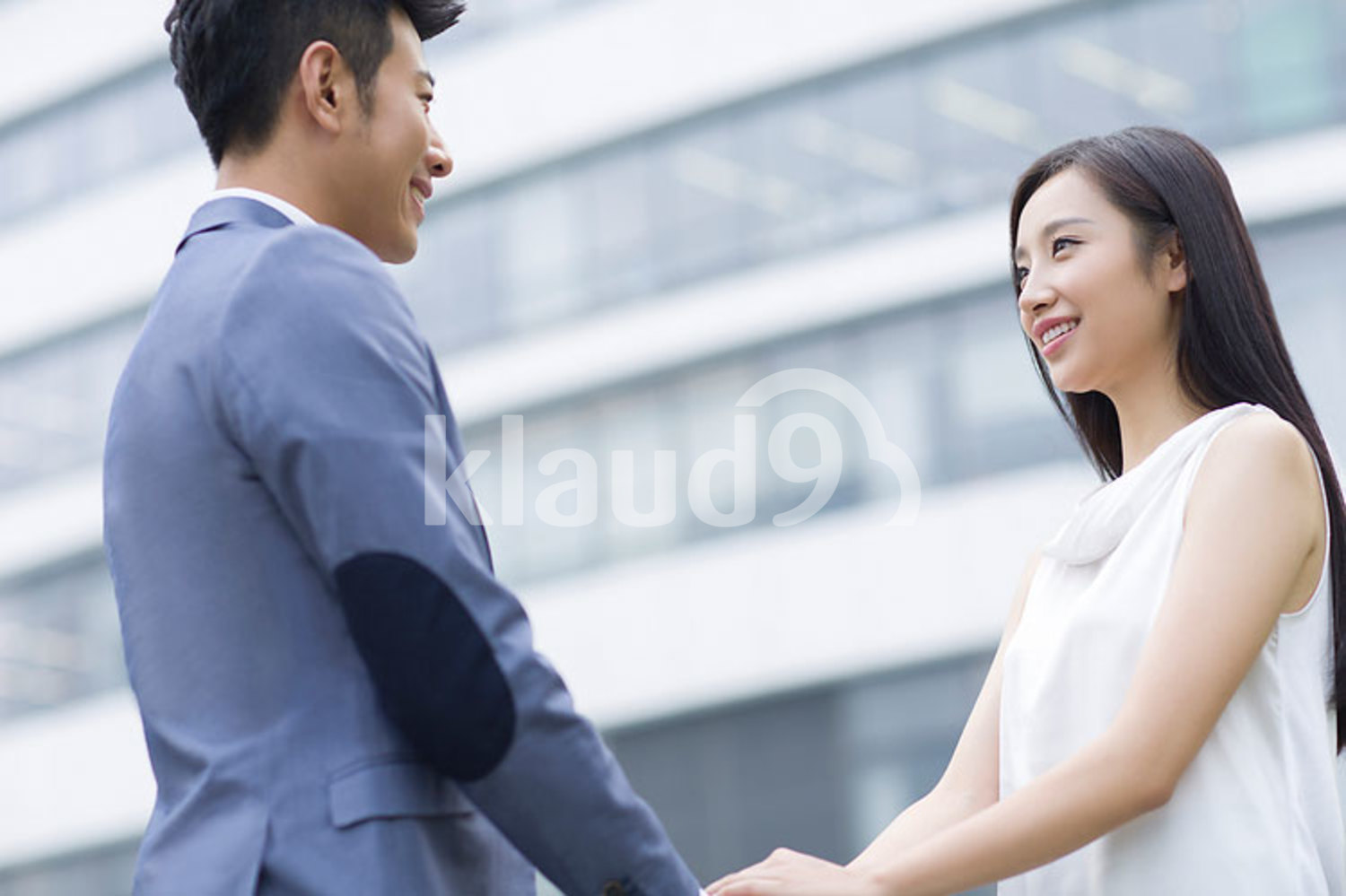 Chinese businesspeople shaking hands