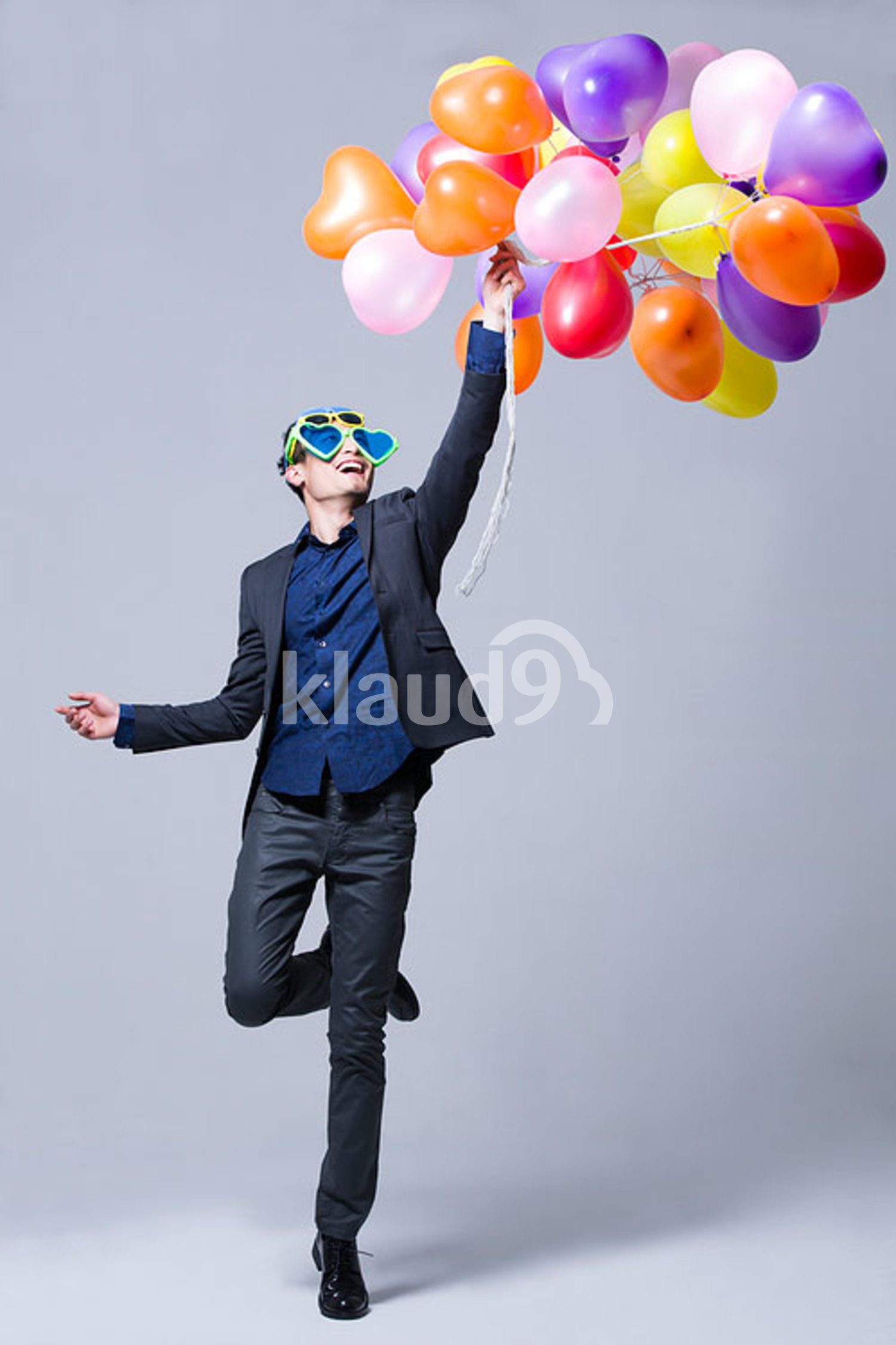Hip young Chinese man with balloons