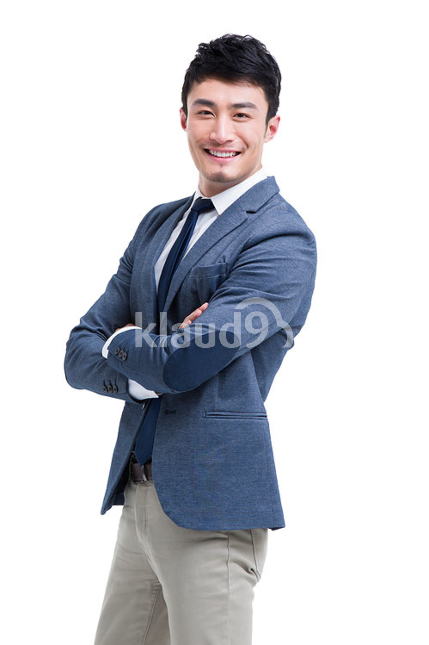 Fashionable Chinese businessman arms crossed