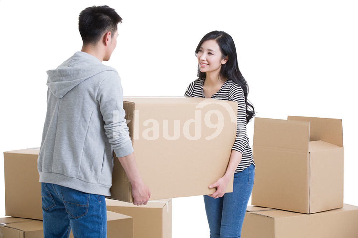 Young Chinese couple moving house
