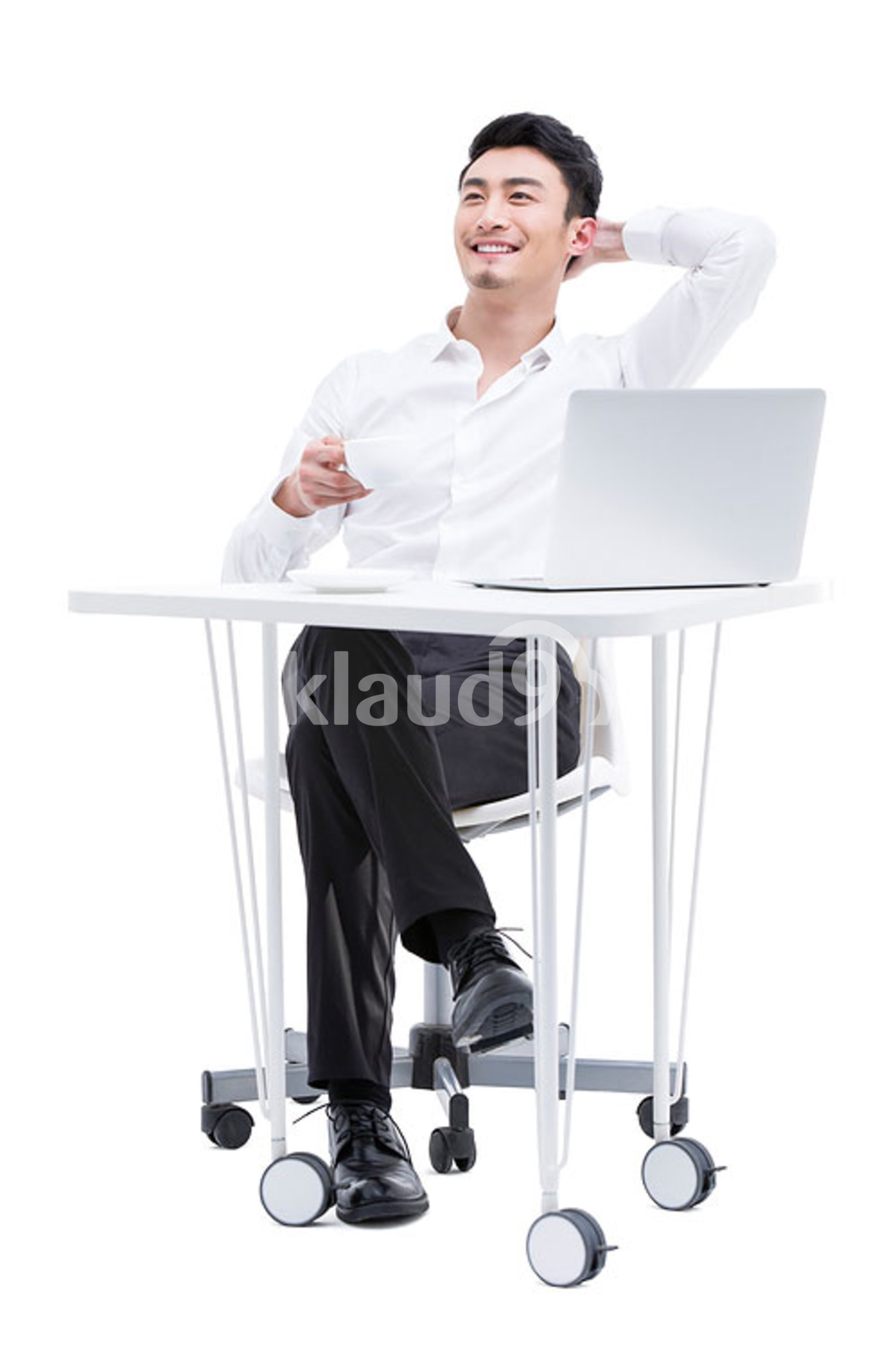 Young Chinese businessman enjoying coffee