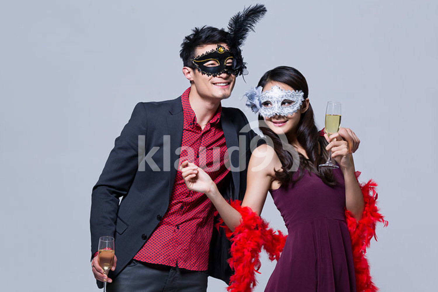 Happy young Chinese couple enjoying a fancy party