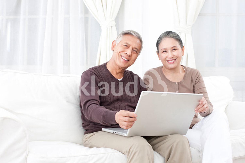 Senior Chinese couple using laptop