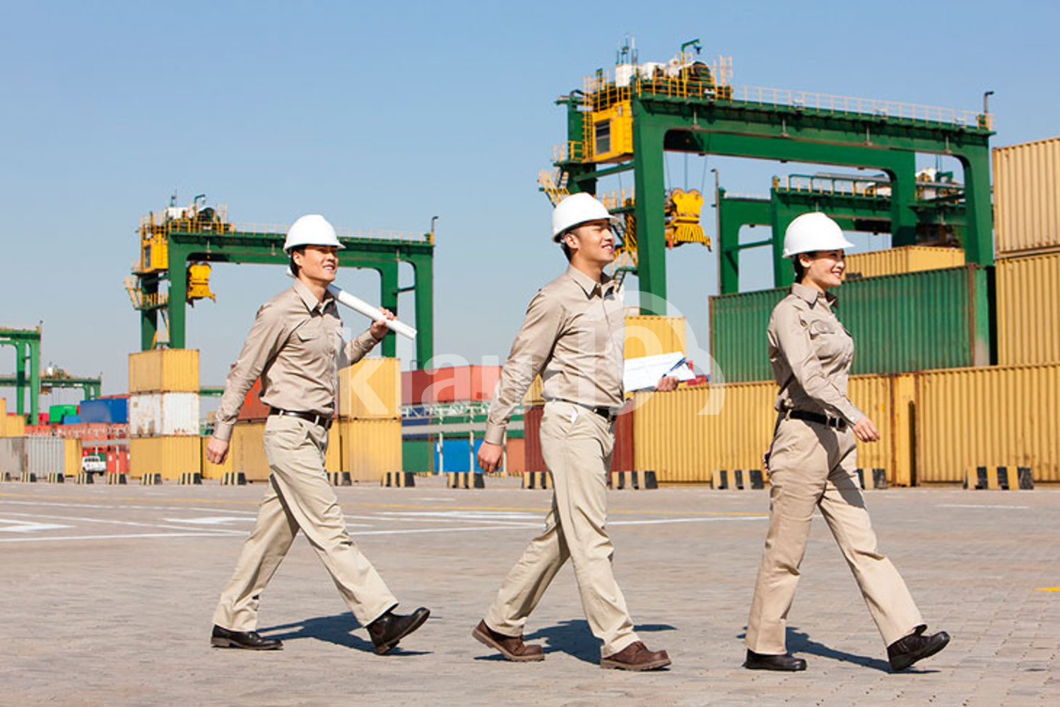 Chinese shipping industry workers walking in a row
