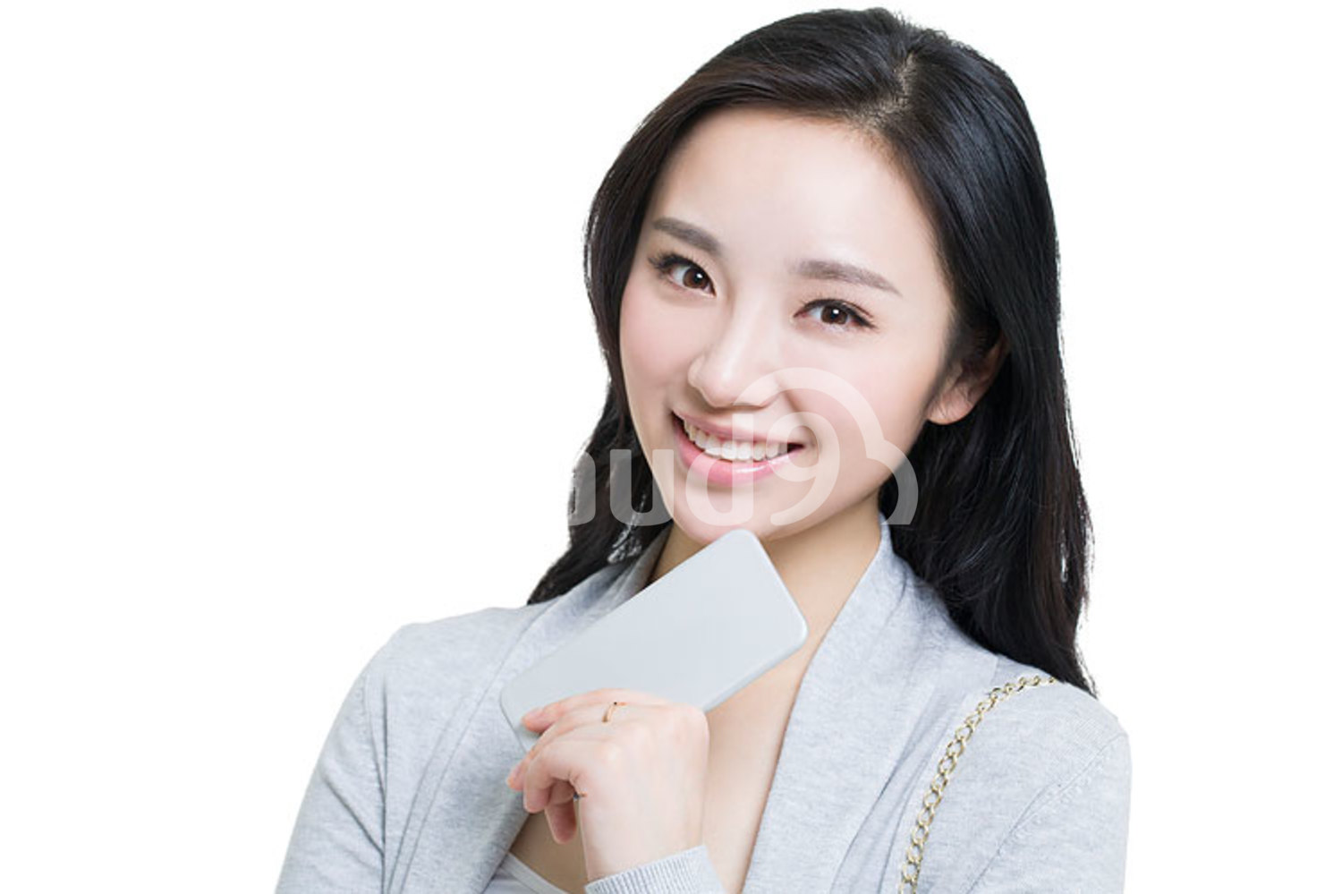 Happy young Chinese woman holding a smart phone