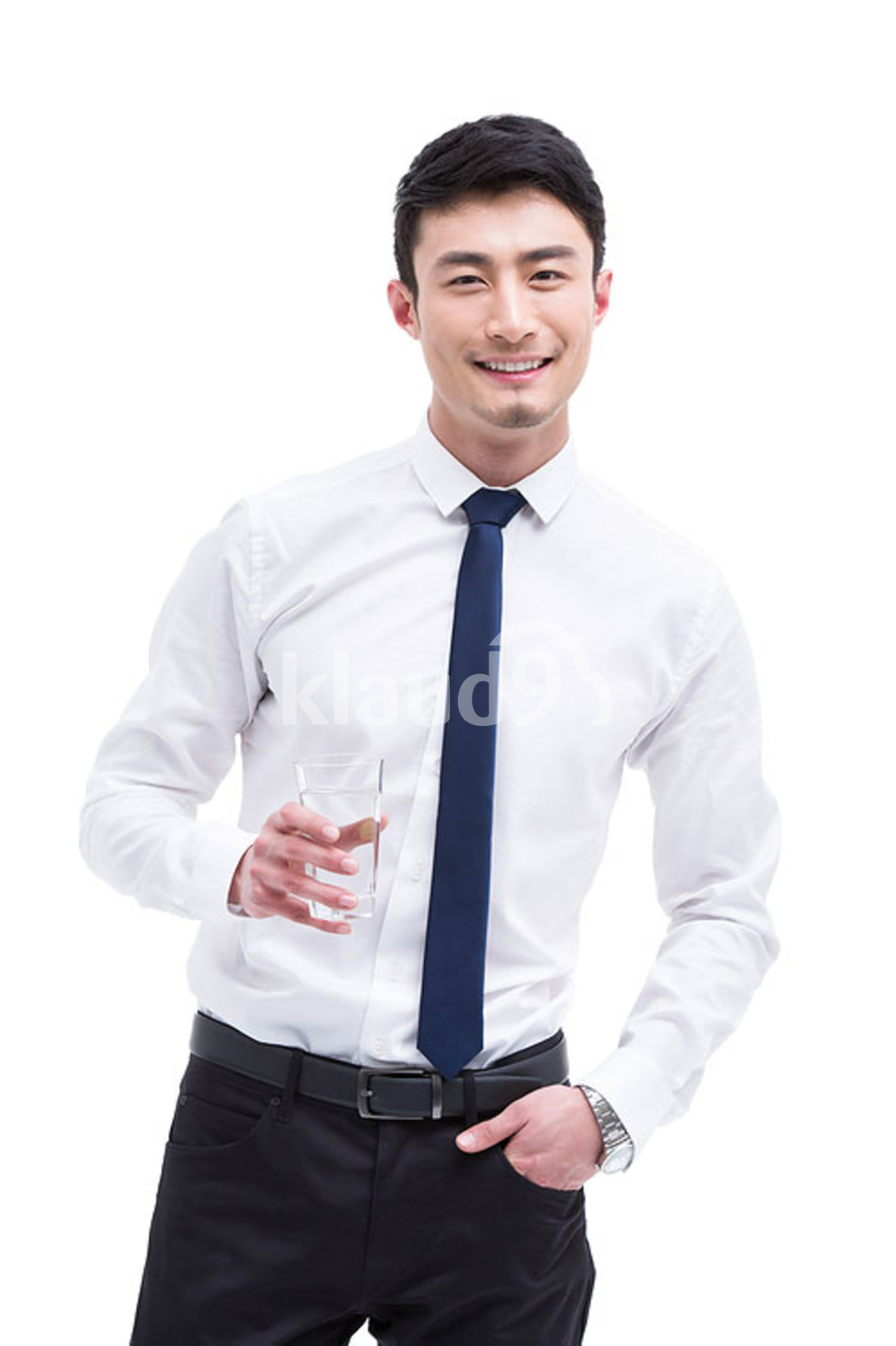 Young Chinese businessman drinking water