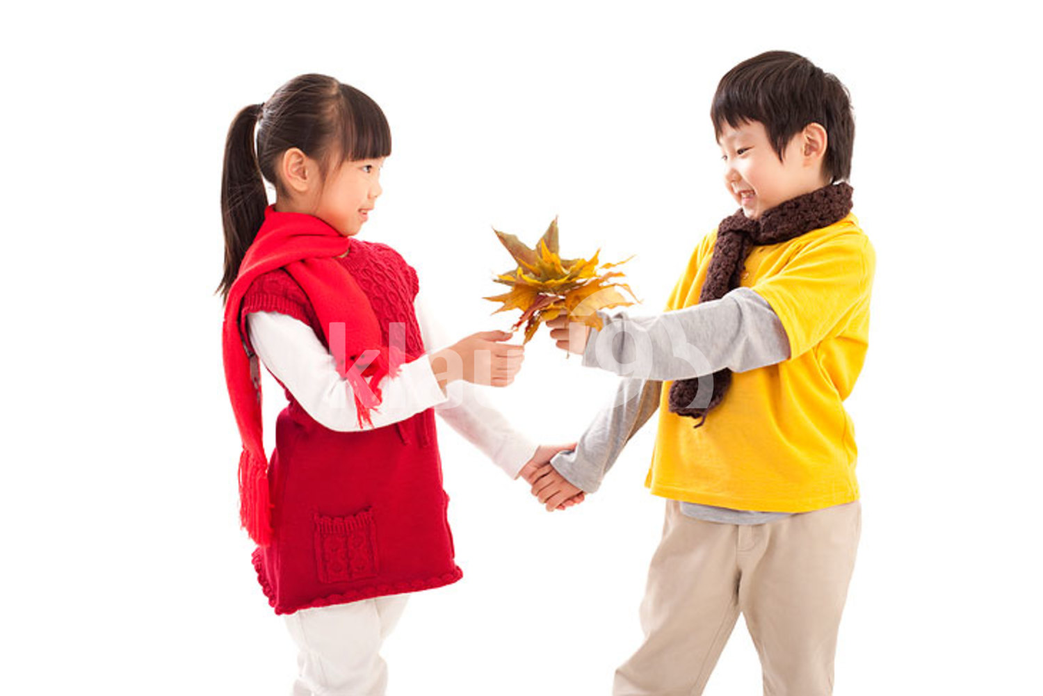 Cute Chinese children and maple leaves