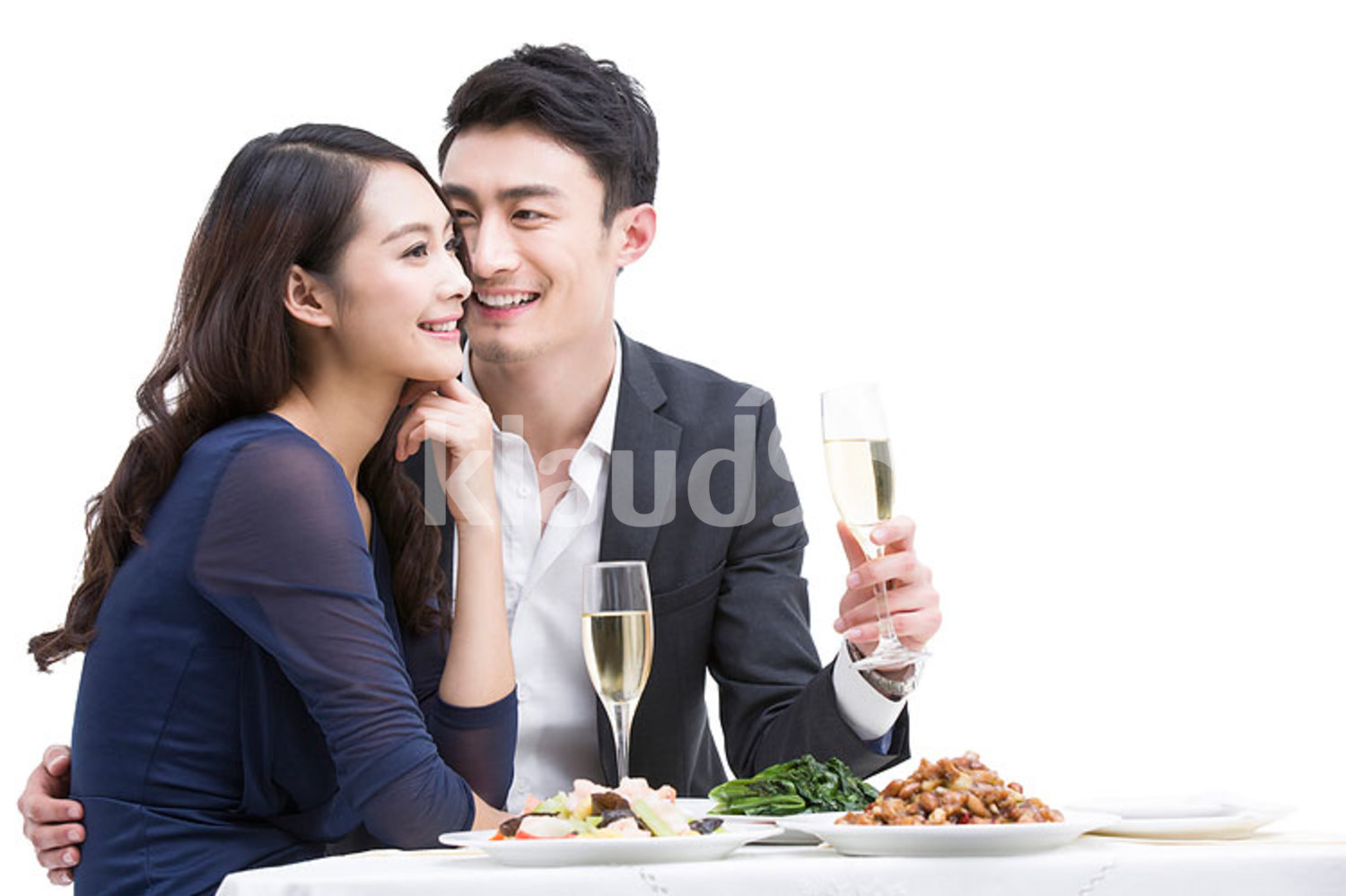 Happy young Chinese couple having dinner