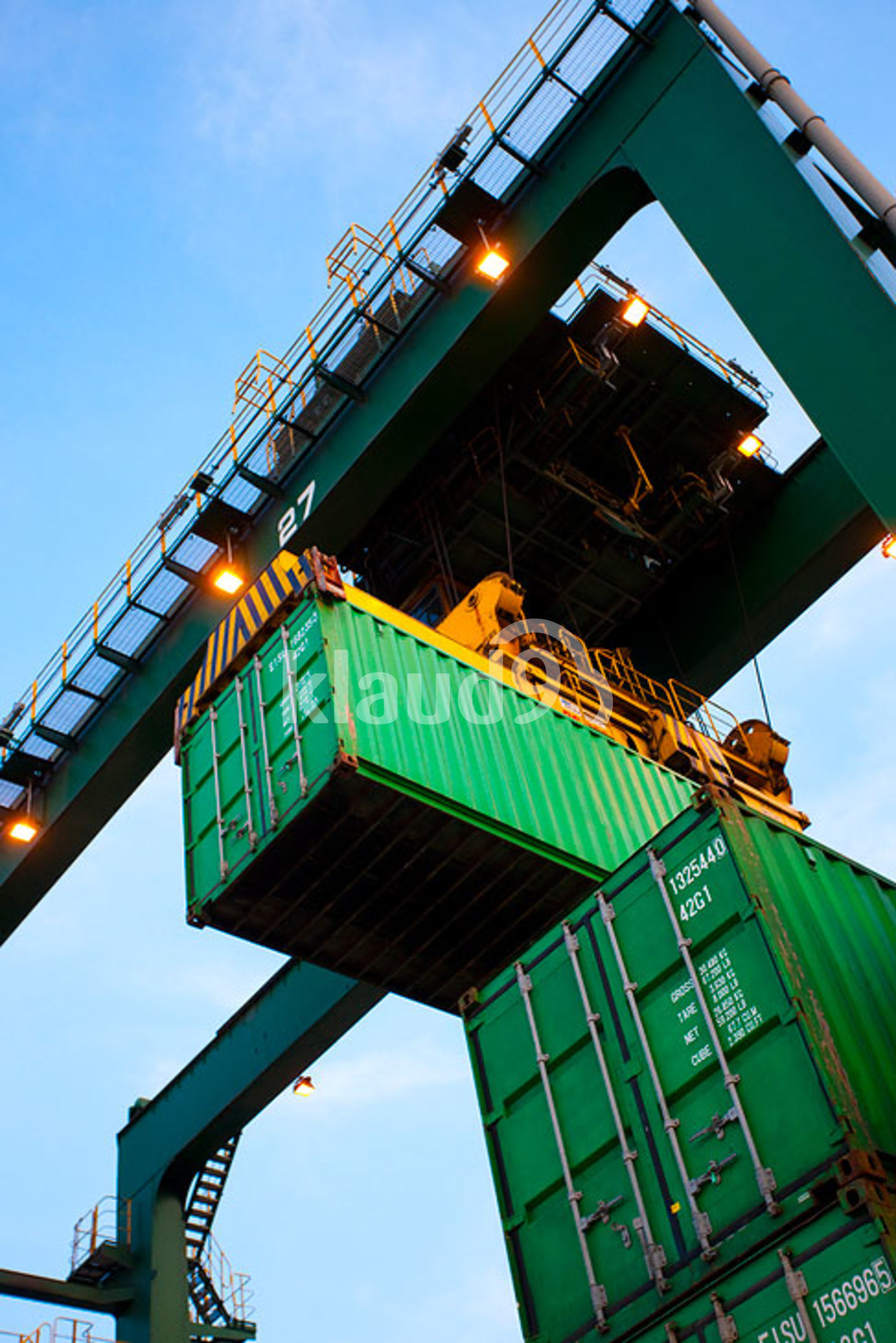 Low angle view of a crane and cargo container at a shipping port