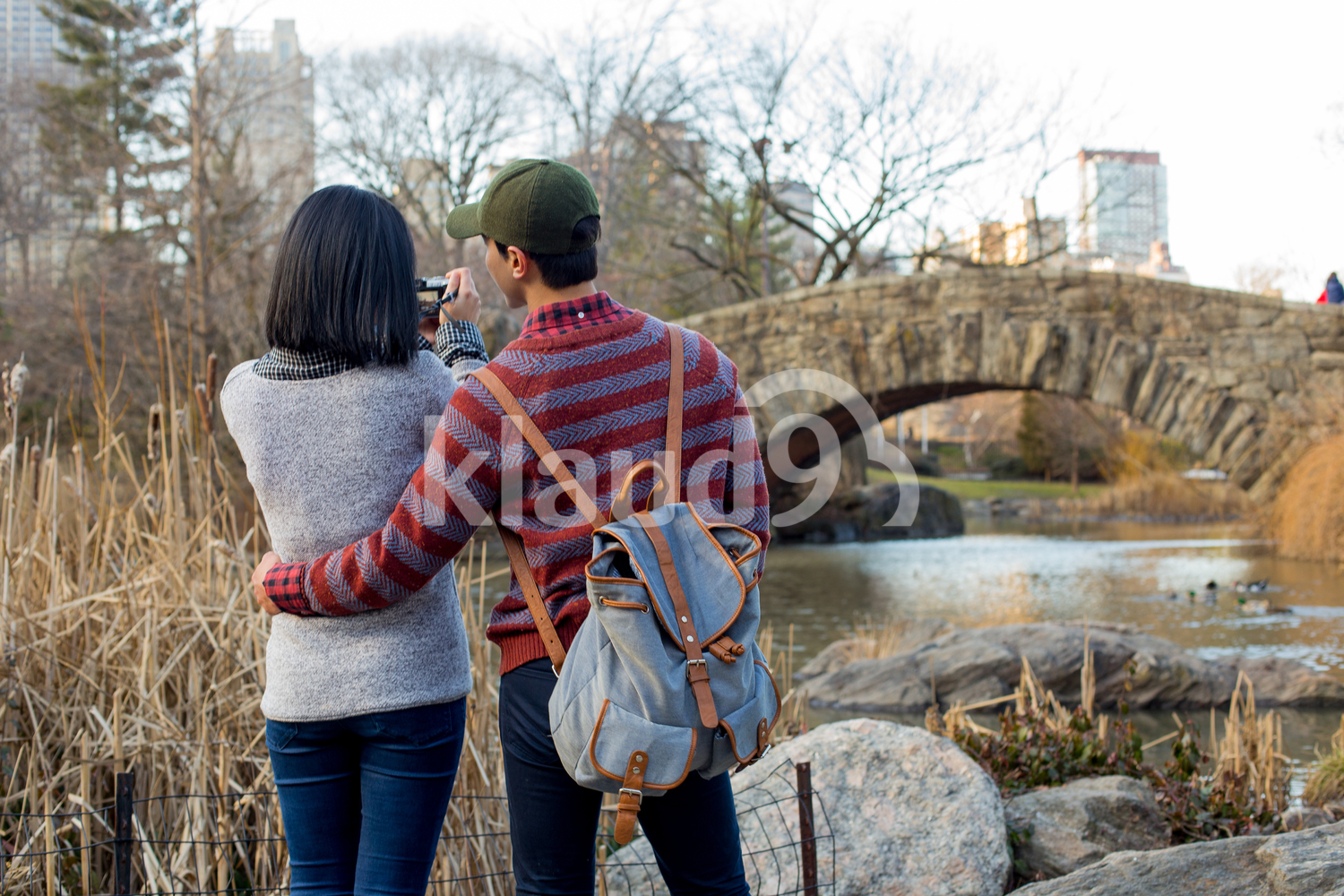 Asian tourists taking photos in Central Park, New York